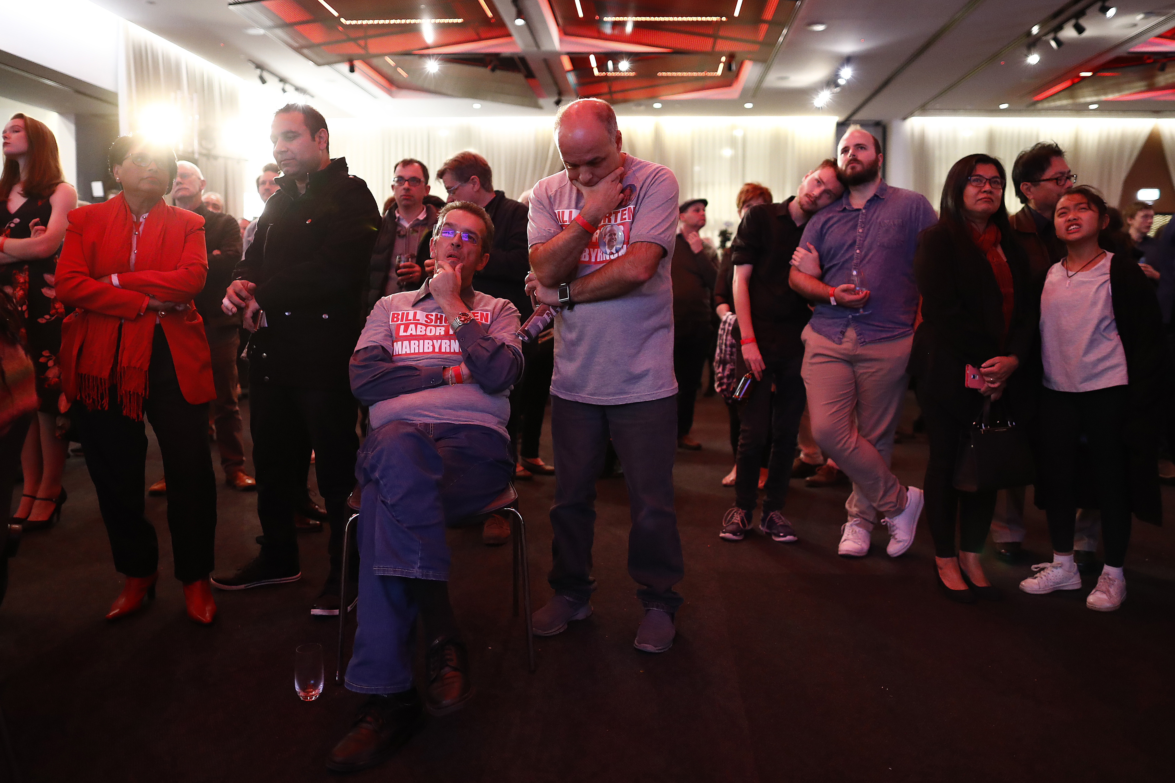 Shattered Labor supporters watch a broadcast of the vote count.