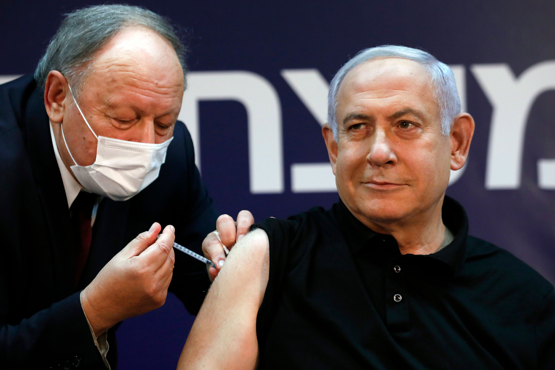 Israeli Prime Minister Benjamin Netanyahu receives a coronavirus vaccine at Sheba Medical Center on Saturday, December 19 in Ramat Gan, Israel.