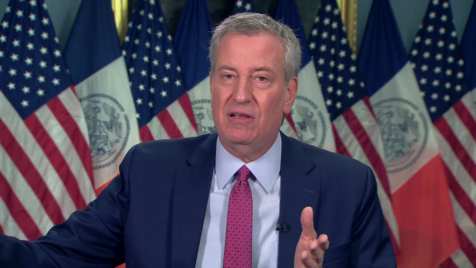 New York City Mayor Bill de Blasio speaks during an interview on November 30.