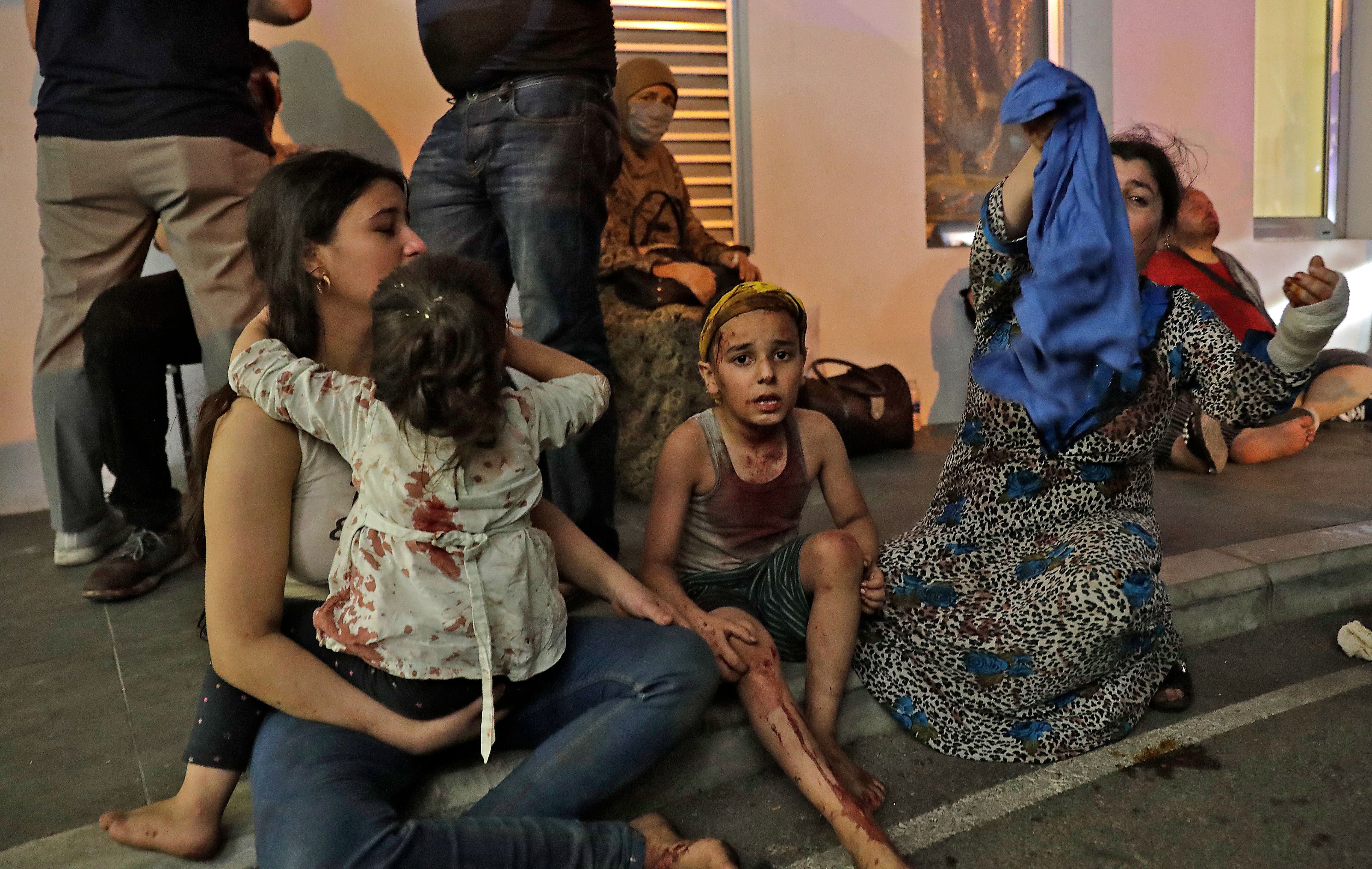 Wounded people wait to receive help outside a hospital on August 4.