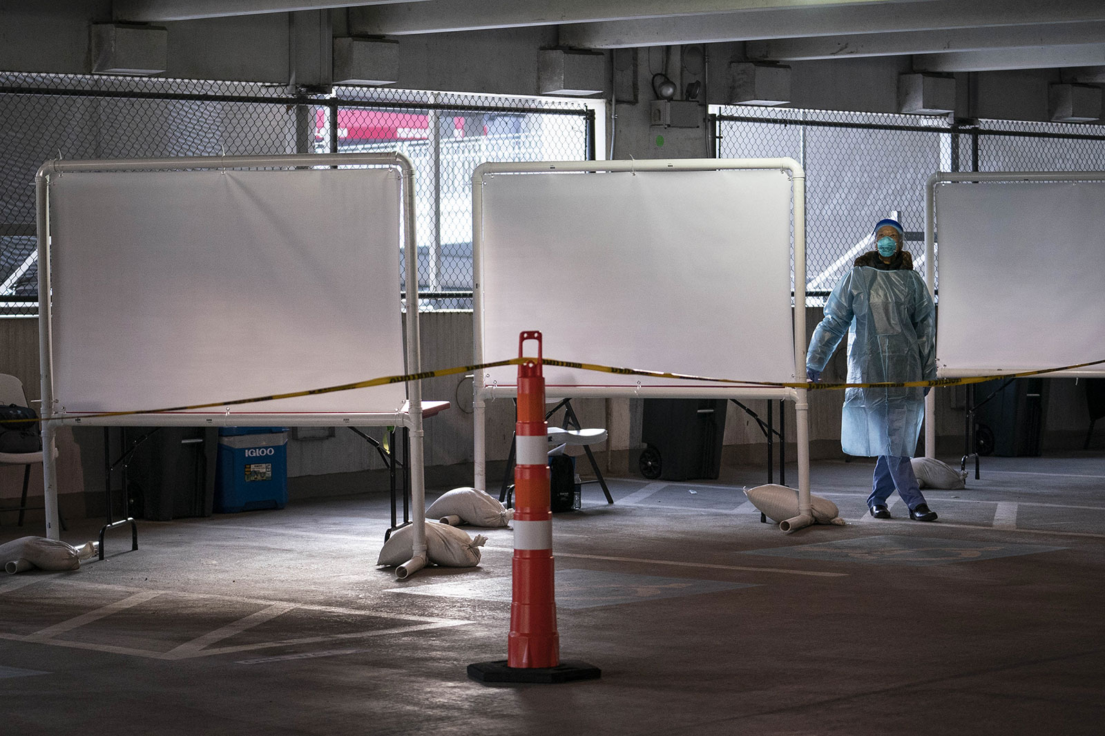 A health care worker waits to administer Covid-19 tests at a testing site in Washington, DC, on November 24.