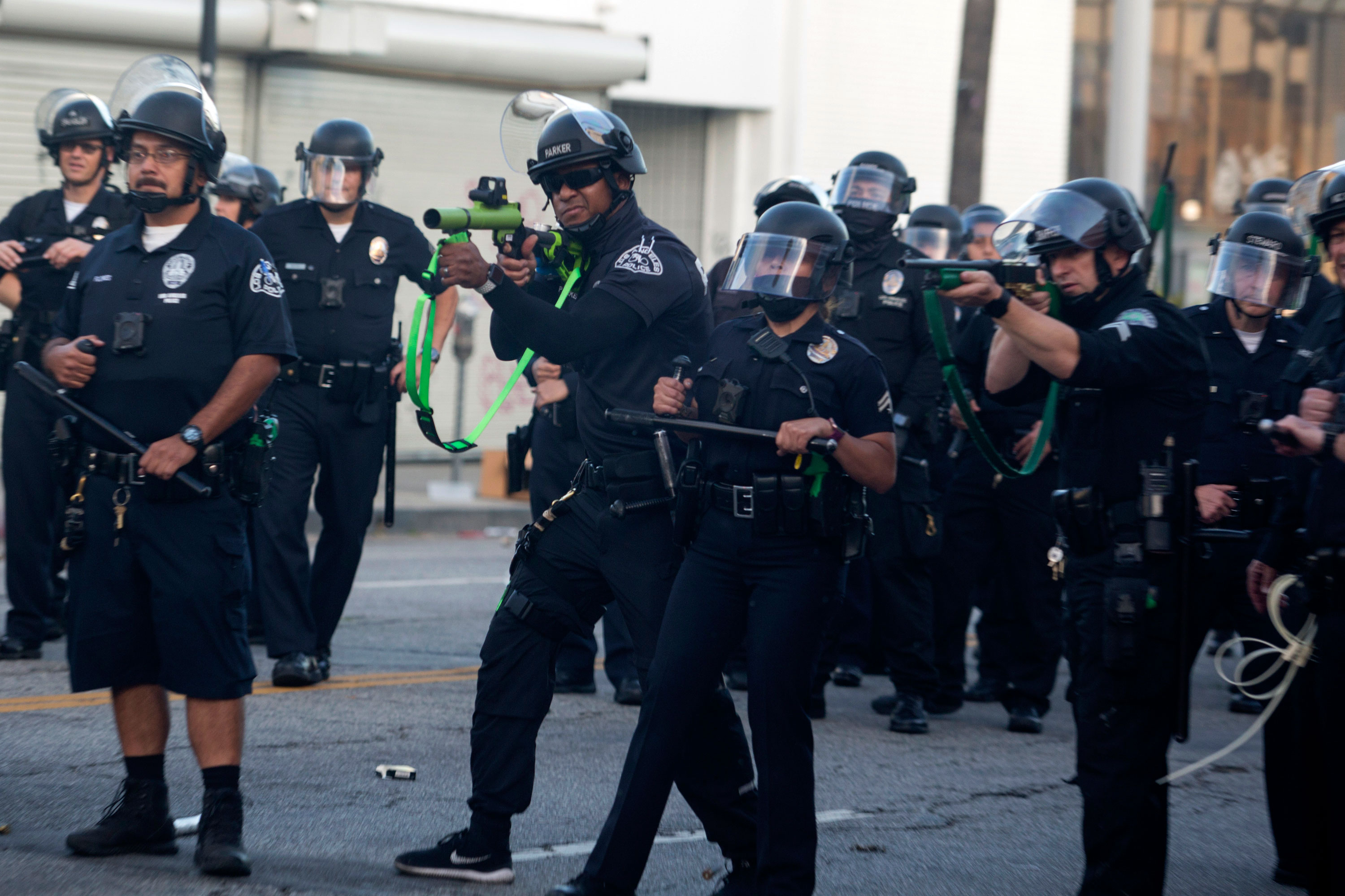 Police officers fire rubber bullets during a protest on Saturday, May 30 in Los Angeles.