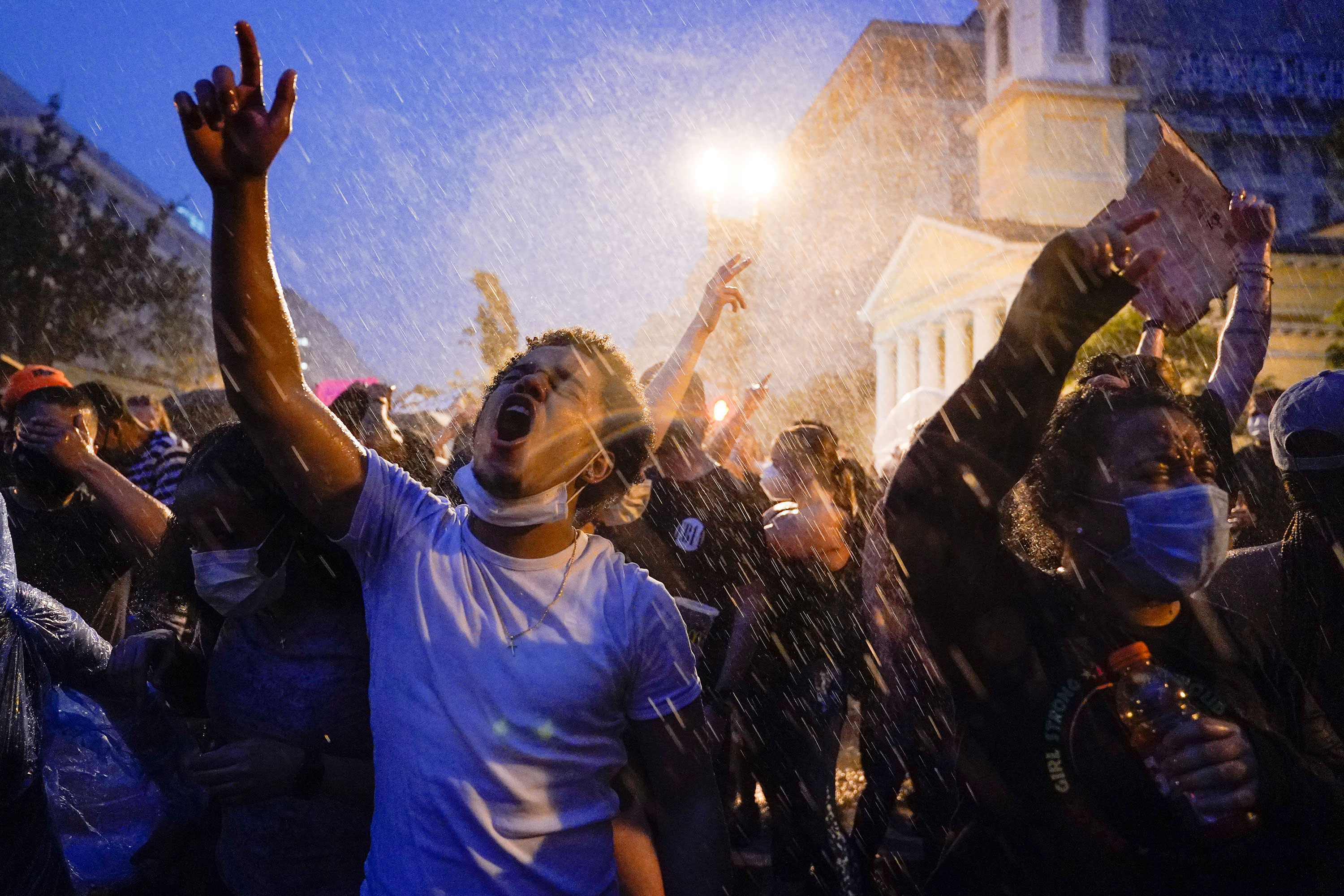 Demonstrators protest in the rain on Thursday night in Washington.