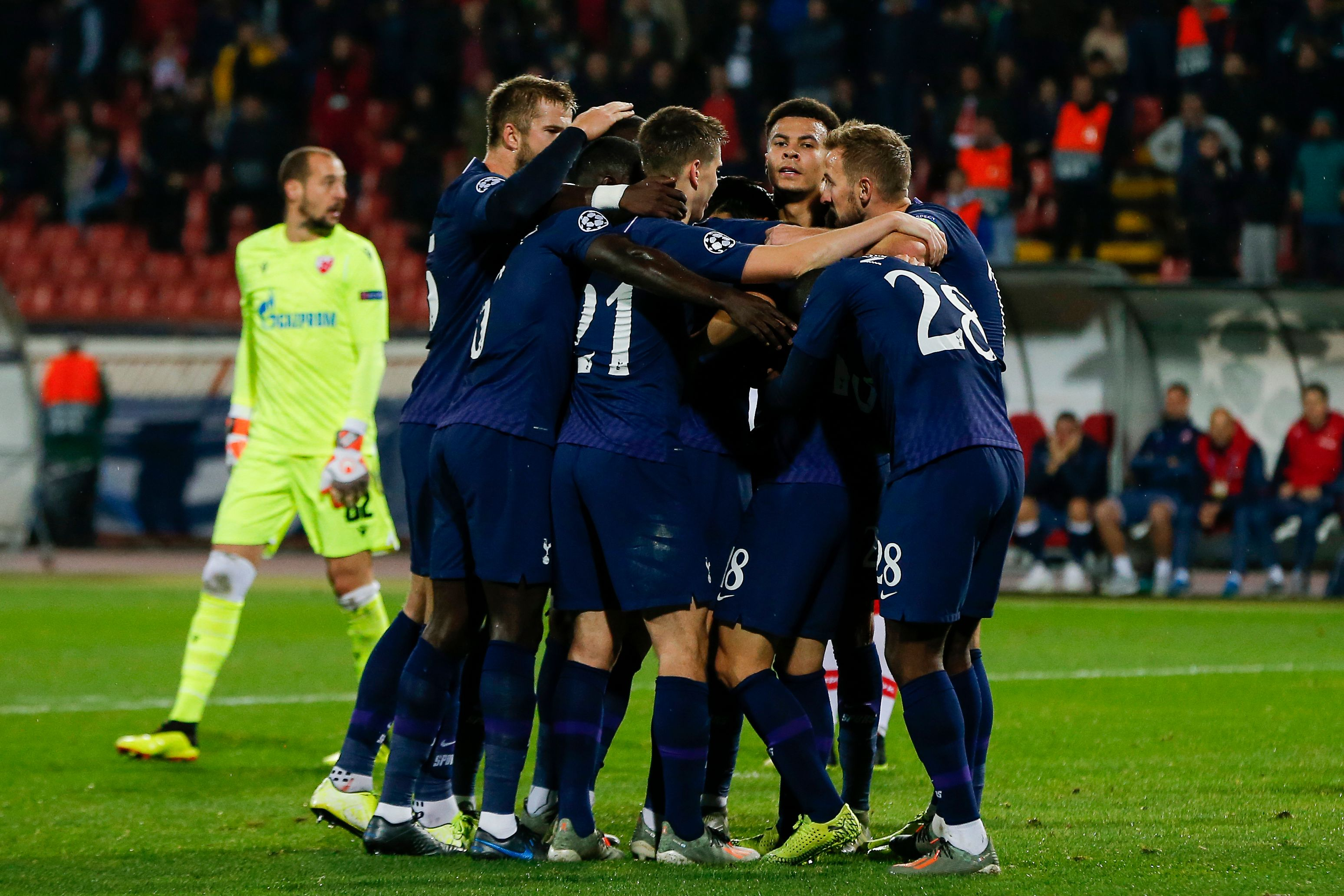 Spurs celebrate as Christian Eriksen fires home a fourth goal against Red Star.