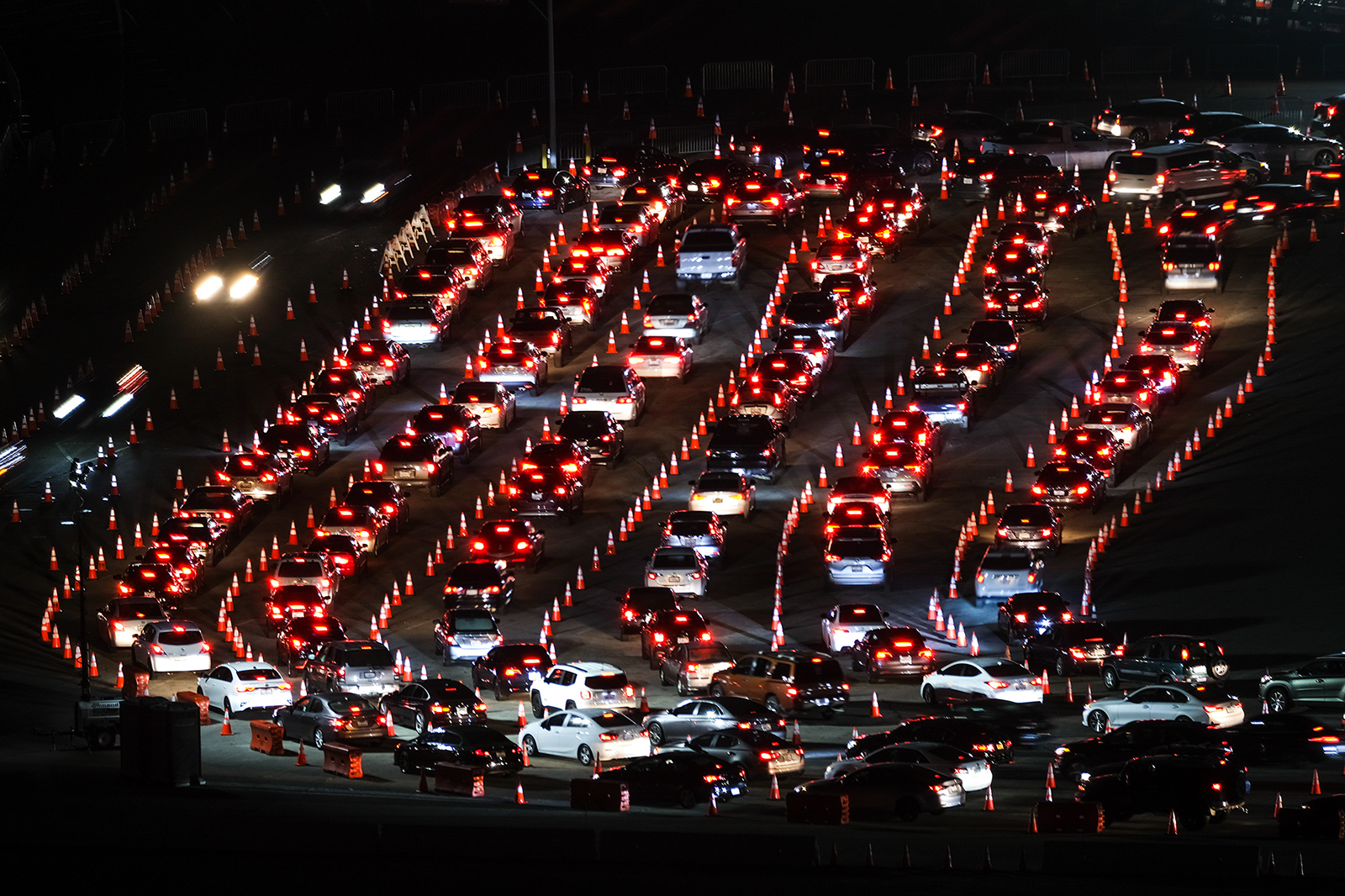 Motorists line up to take a coronavirus test in a parking lot at Dodger Stadium on Monday, January 4, in Los Angeles.
