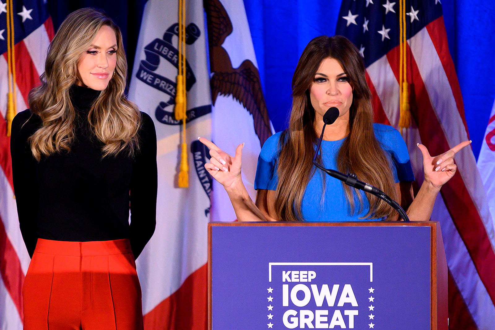 """Donald Trump Jr's girlfriend Kimberly Guilfoyle, right, speaks with Lara Trump, the wife of Eric Trump, during a """"Keep Iowa Great"""" press conference in Des Moines, Iowa, on February 3."""