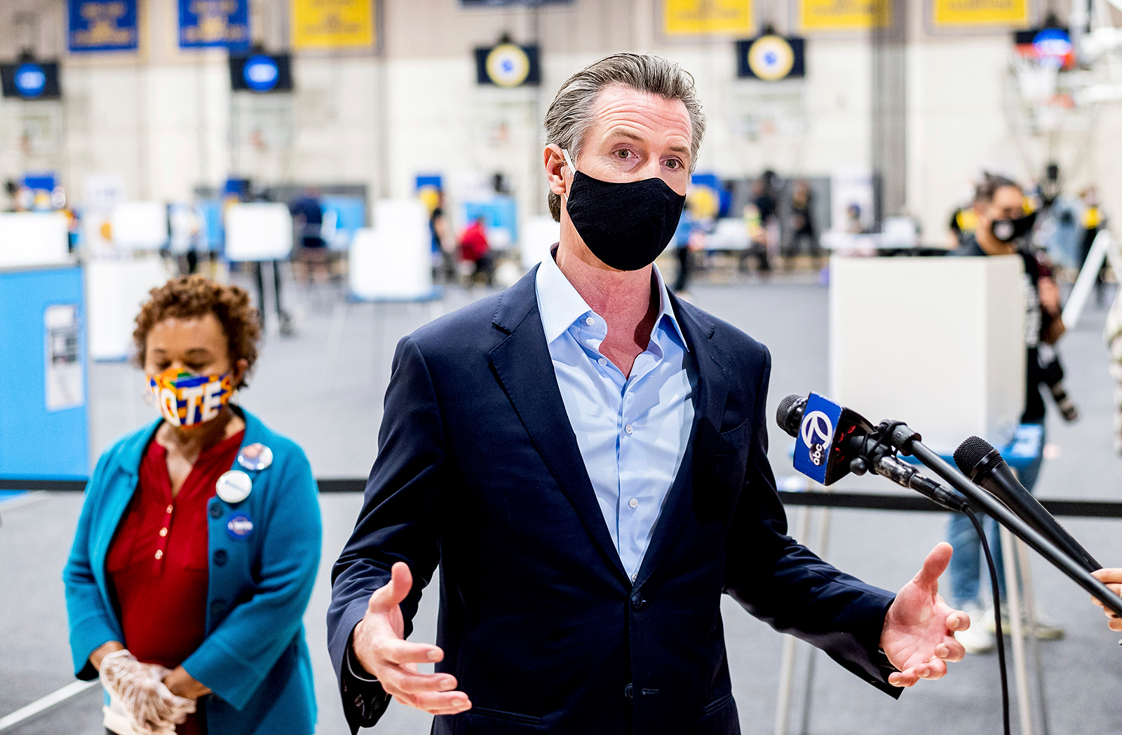 Gov. Gavin Newsom discusses the 2020 election while visiting the Golden State Warriors training facility, which is serving as a polling location, on Tuesday, Nov. 3, in Oakland, Calif.