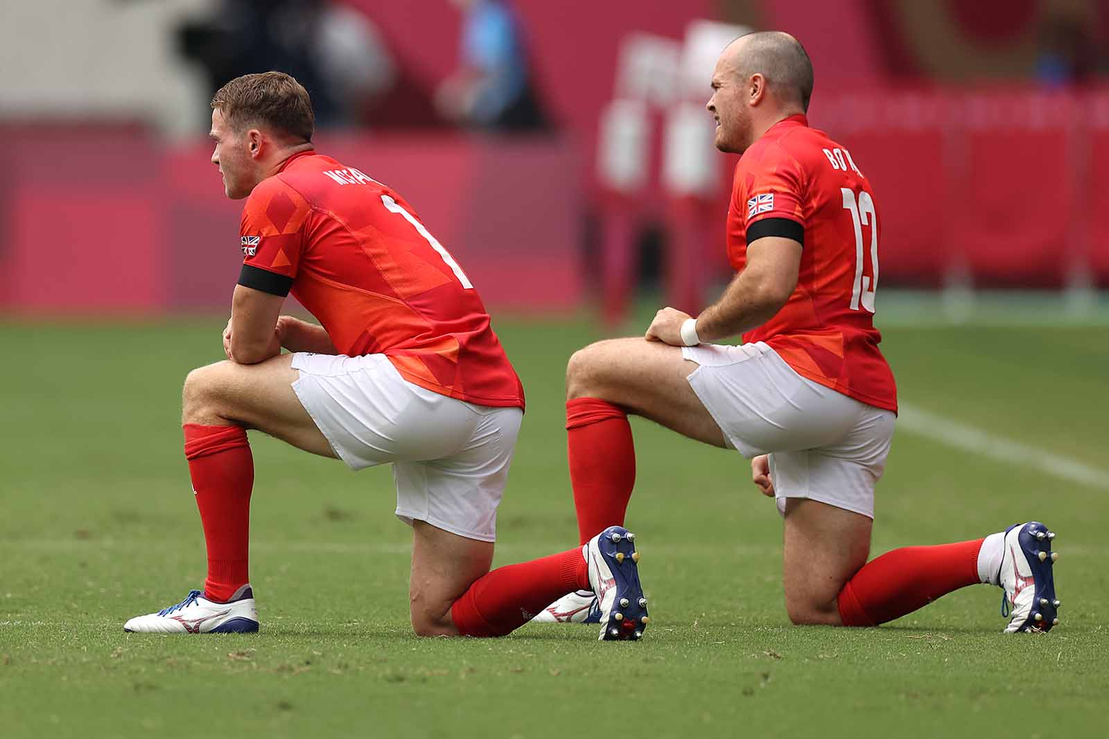 Team GB players take a knee during the Rugby Sevens Men's semifinal match between New Zealand and Great Britain on July 28.