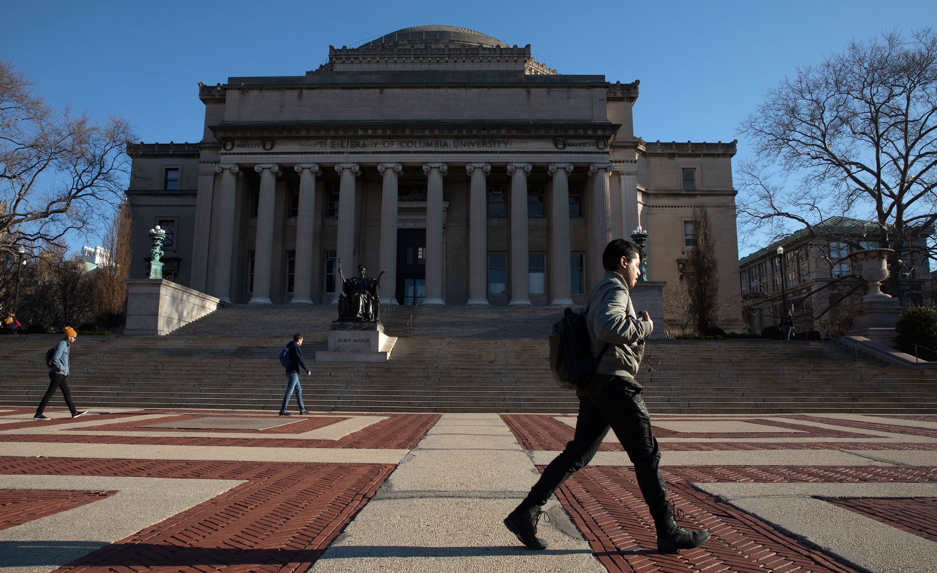 People walk around the Columbia University campus in New York on March 9.