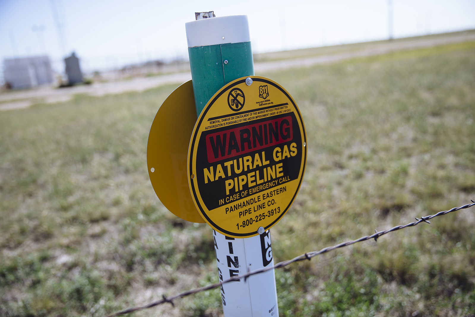 A warning sign for an underground natural gas pipeline stands near Sunray, Texas, U.S., on Saturday, Sept. 26, 2020.