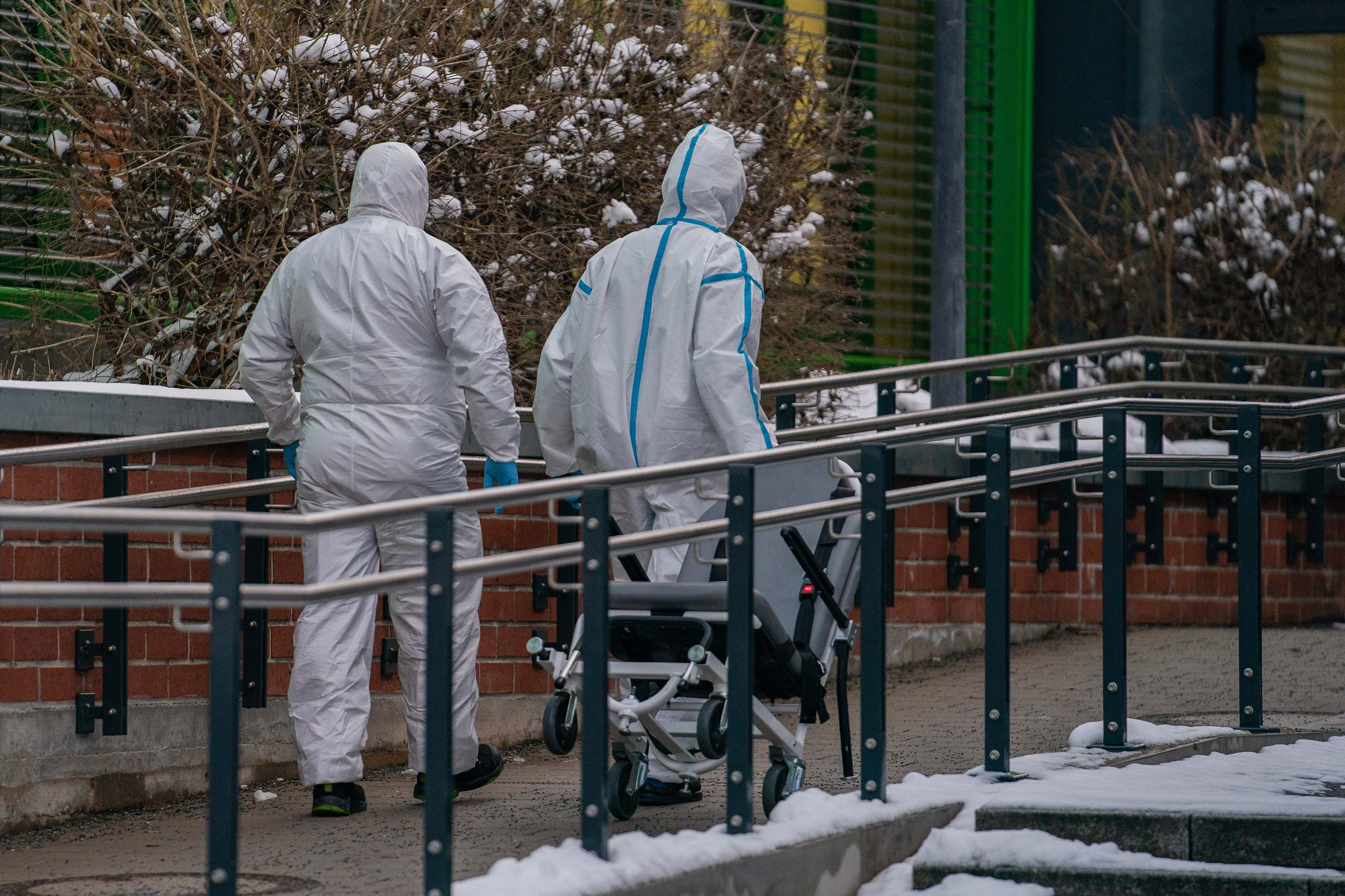 Medical staff walk towards the main entrance of a hospital in Bayreuth, Germany, on January 26.