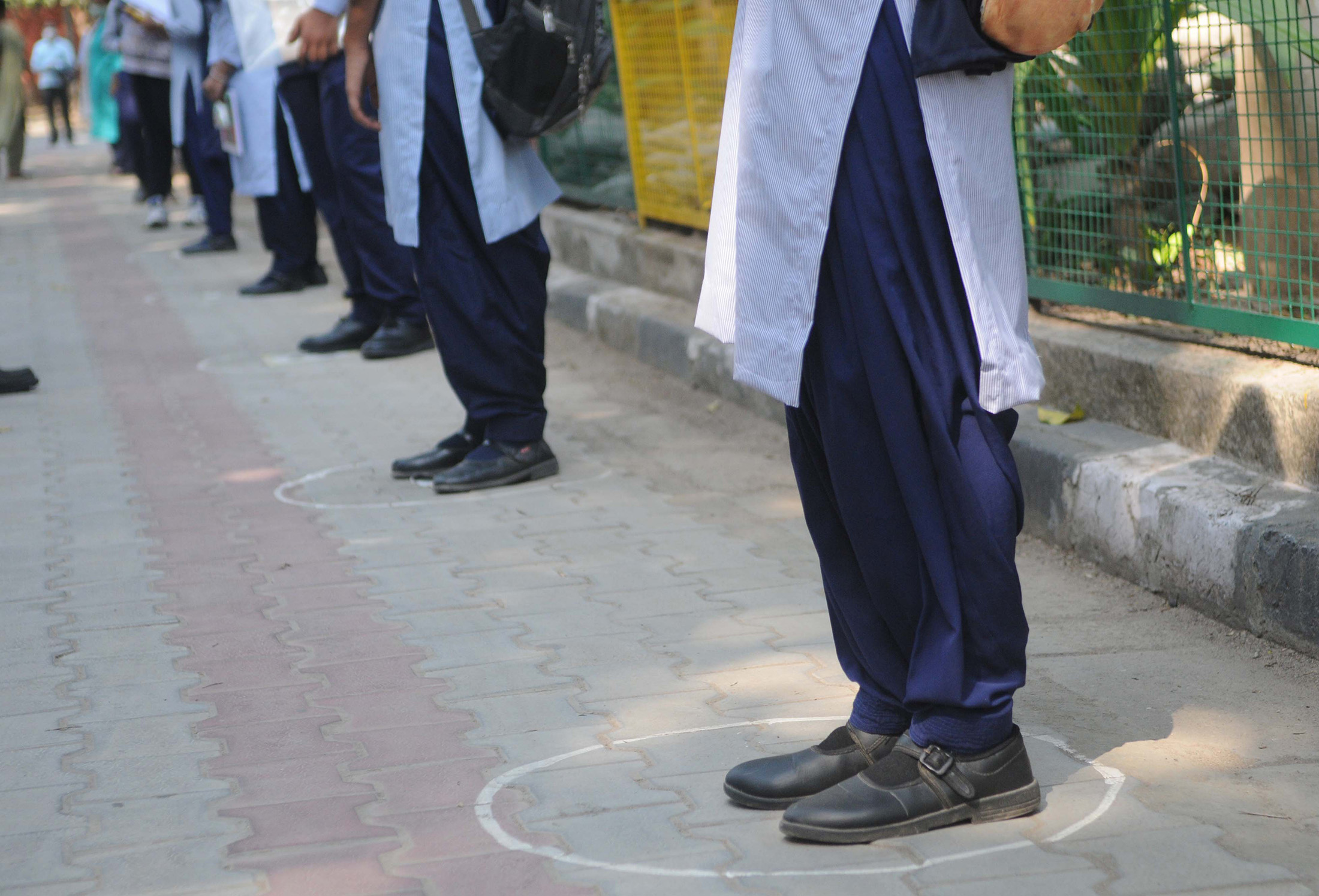 Students stand in circles for social distancing at the Government Model Senior Secondary School, on November 2, in Chandigarh, India.