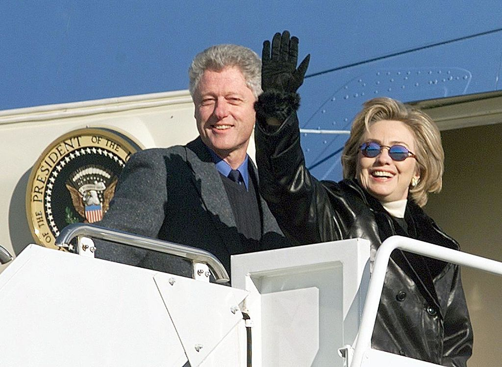 President Clinton and first lady Hillary Rodham Clinton depart Andrews Air Force Base in December 1998.