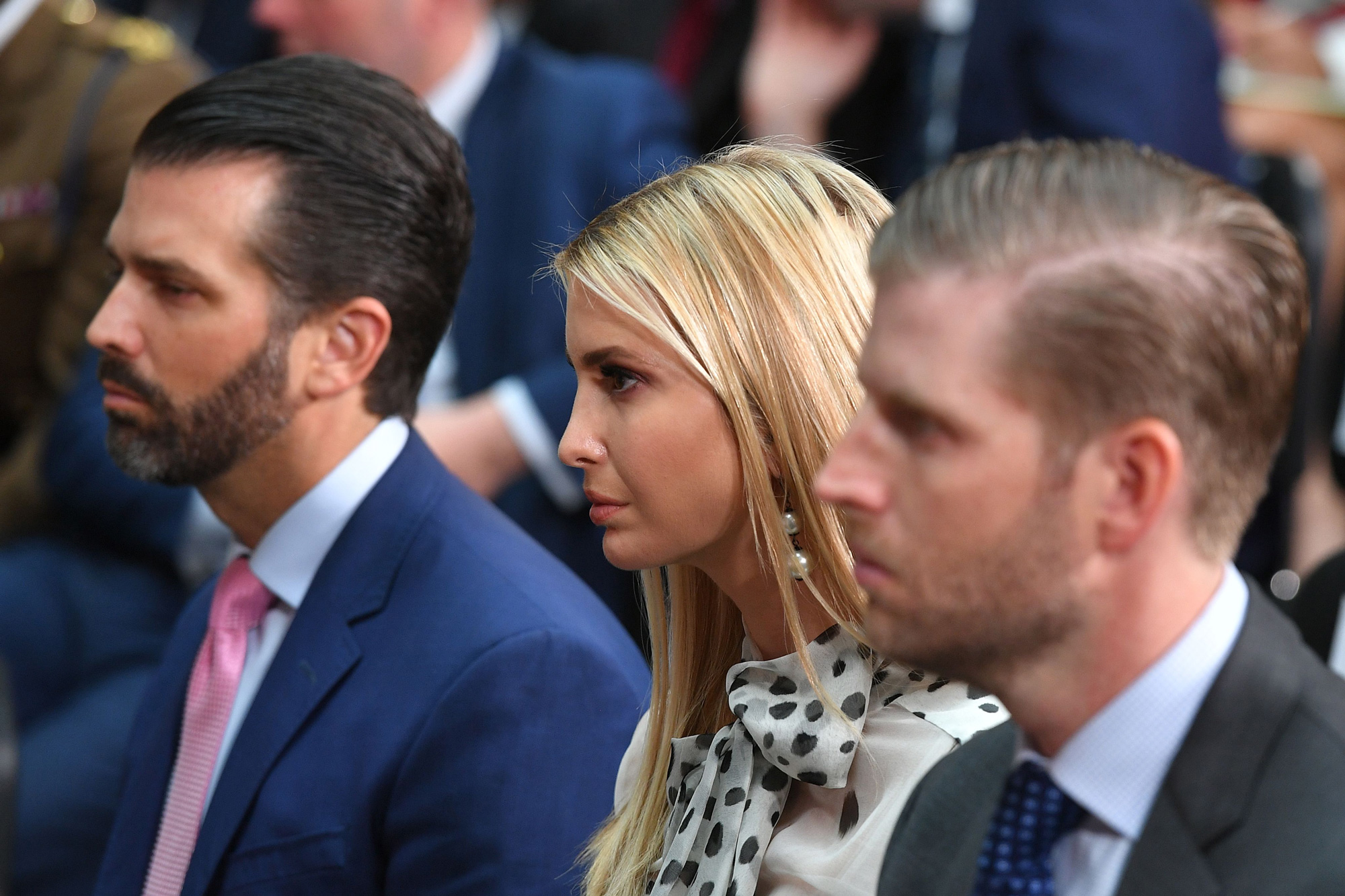 Donald Trump Junior, left, Ivanka Trump, center, and Eric Trump listen during a joint press conference at the Foreign and Commonwealth office in London on June 4, 2019.