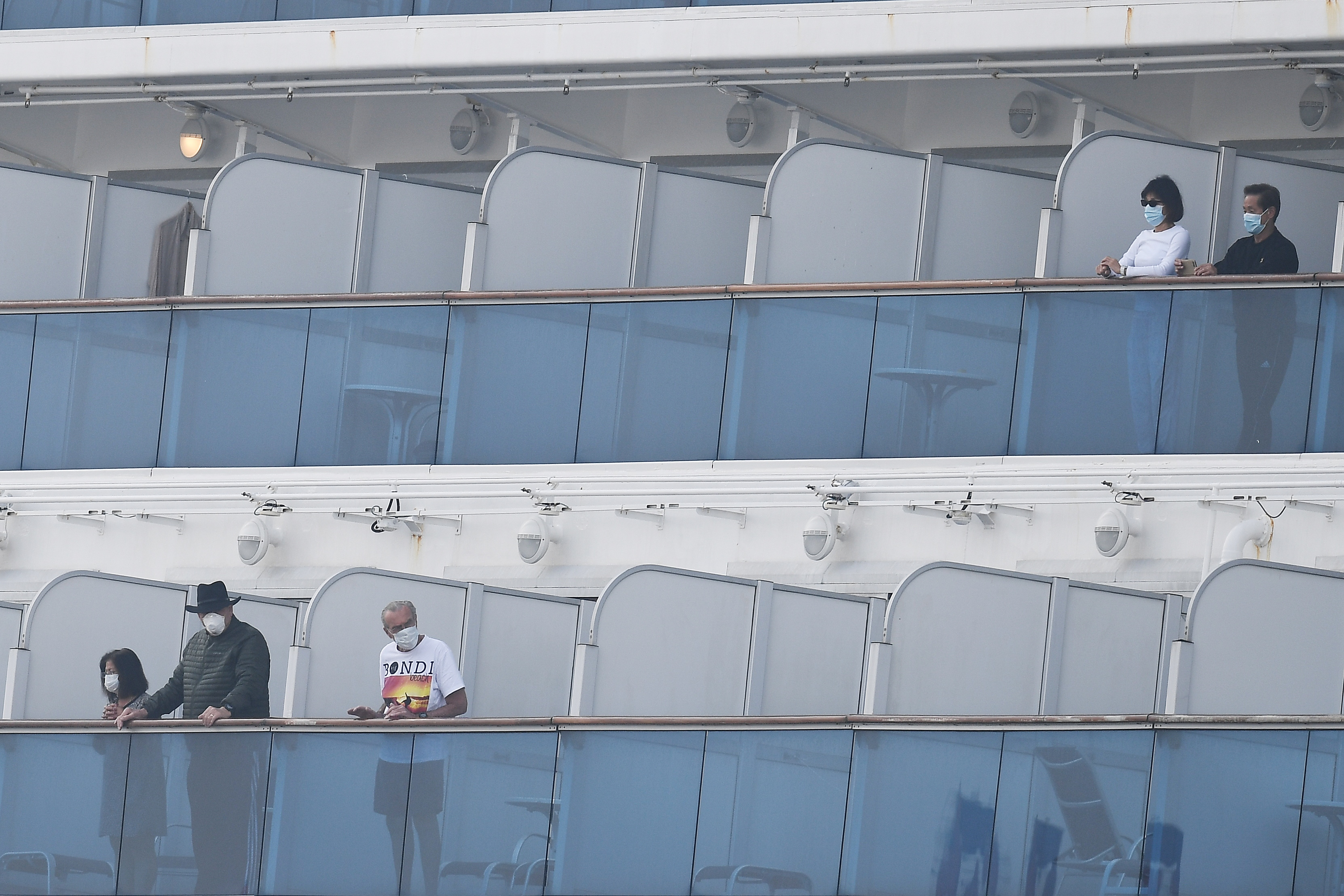 Passengers on balconies of the Diamond Princess cruise ship, docked in Yokohama, Japan, on February 14.