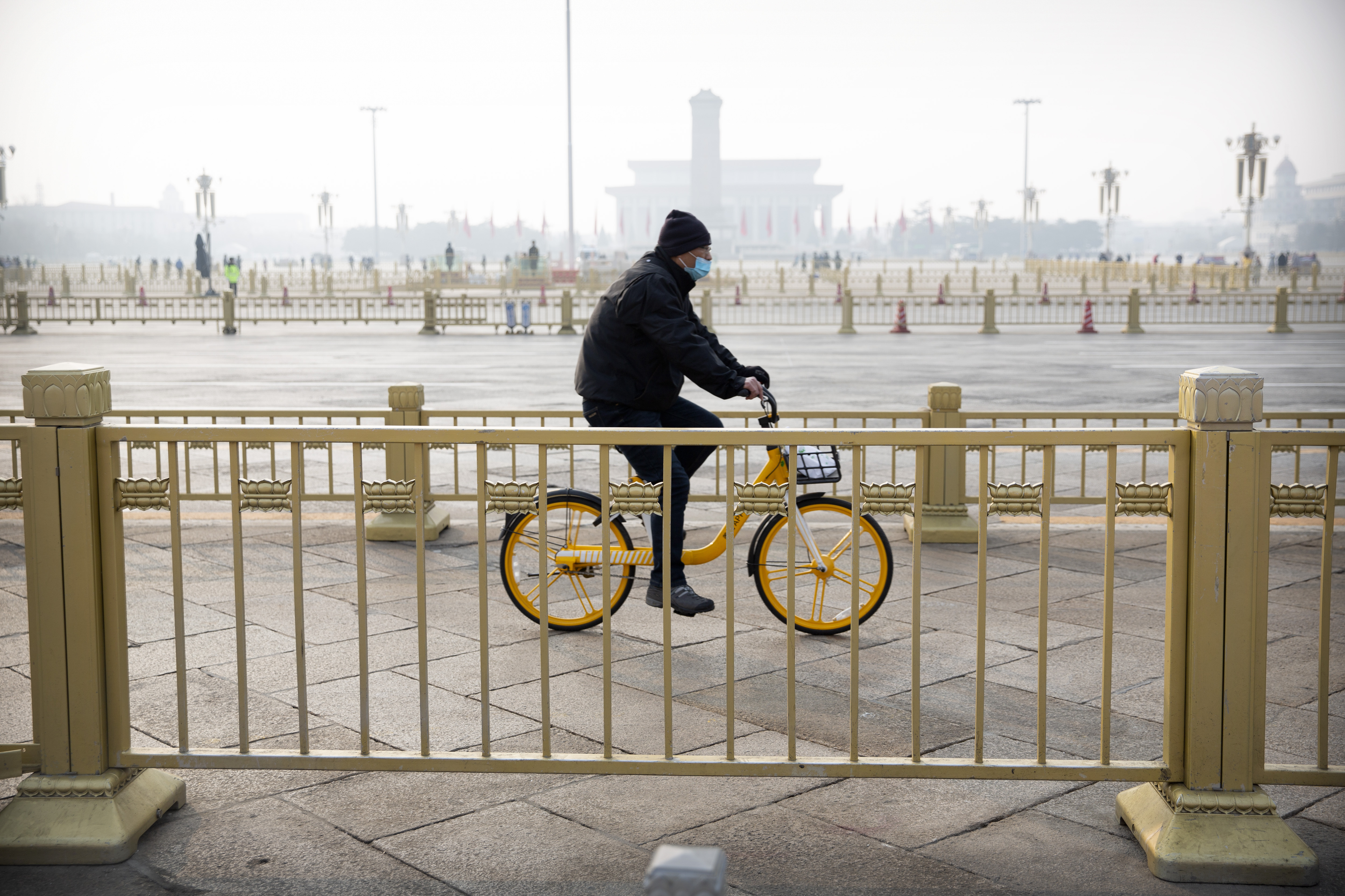 A cyclist rides past Beijing's Tiananmen Square, normally crowded with tourists during the Lunar New Year holiday, on January 27.