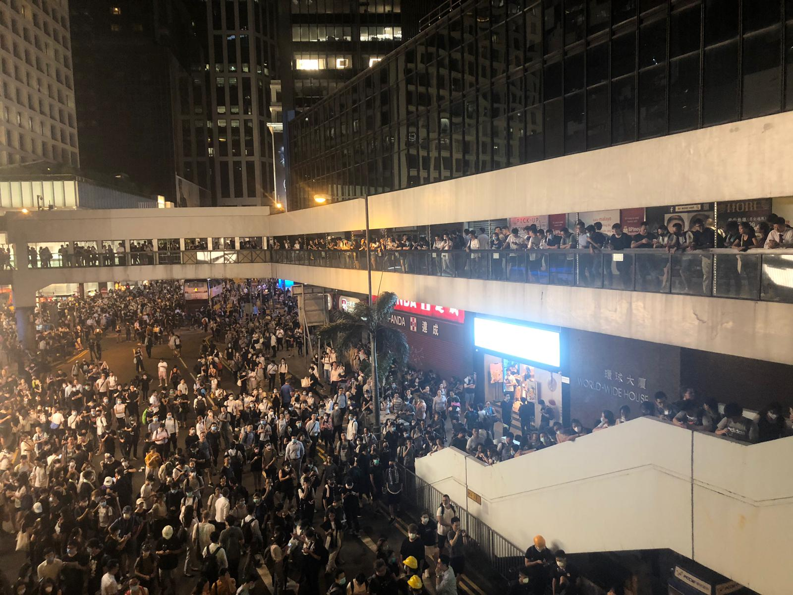 Protesters move towards Central, with crowds near World Wide House between Connaught Road Central, Pedder Street and Des Voeux Road Central.
