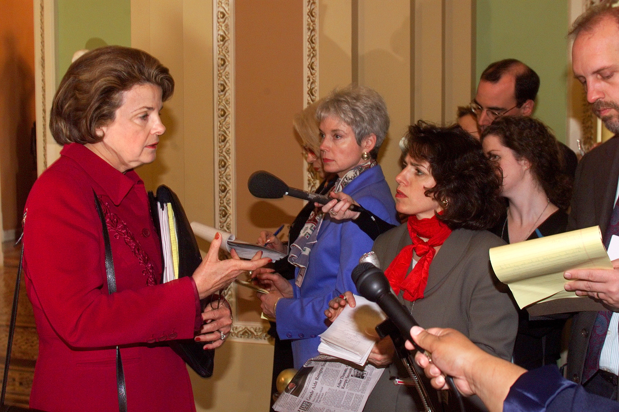 Sn. Dianne Feinstein (D-CA) speaks with reporters outside the US Senate during the sixth day of impeachment trial proceedings against Bill Clinton.