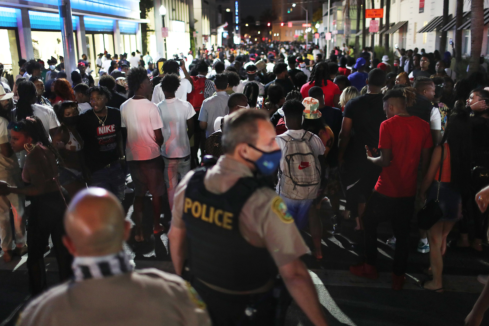 People leave the area as an 8pm curfew goes into effect in Miami Beach, Florida, on March 21.