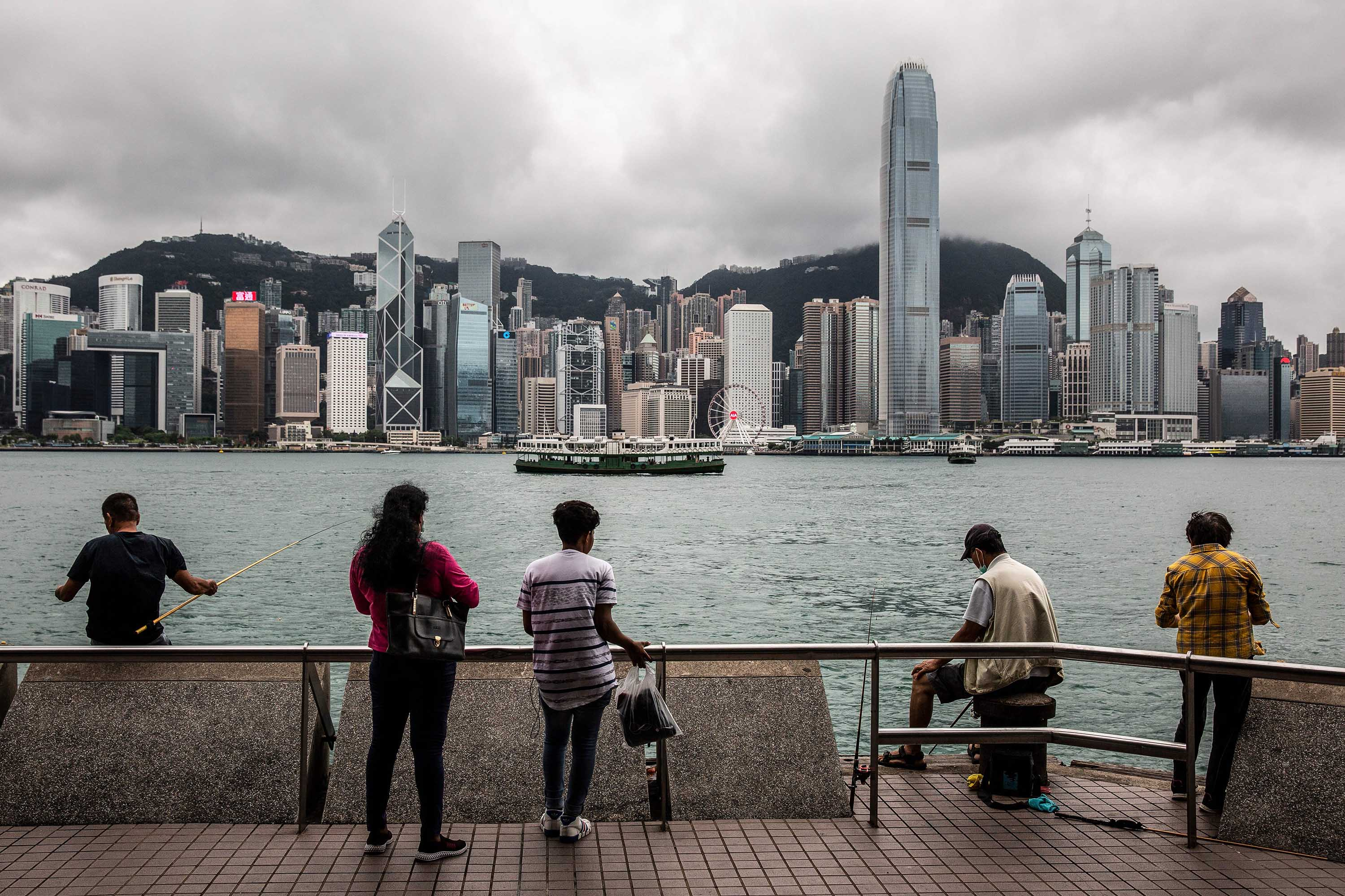 People are seen on the waterfront of Victoria Harbour in Hong Kong, on May 31.