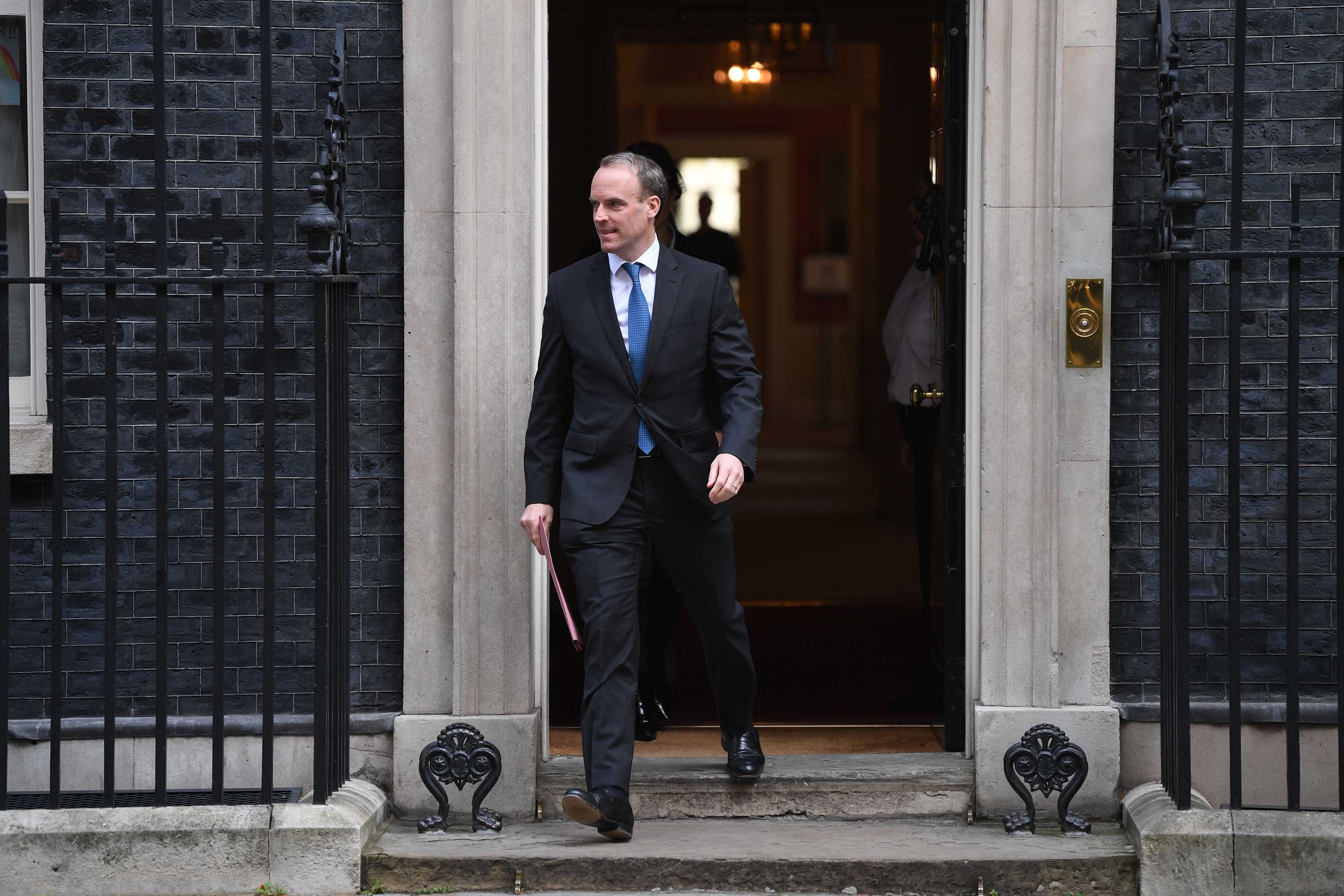 Britain's Foreign Secretary Dominic Raab leaves number 10 Downing street in central London after the daily Covid-19 briefing on April 15. Raab, who is filling in for Prime Minister Boris Johnson, will participate in a G7 leaders conference call on Thursday.
