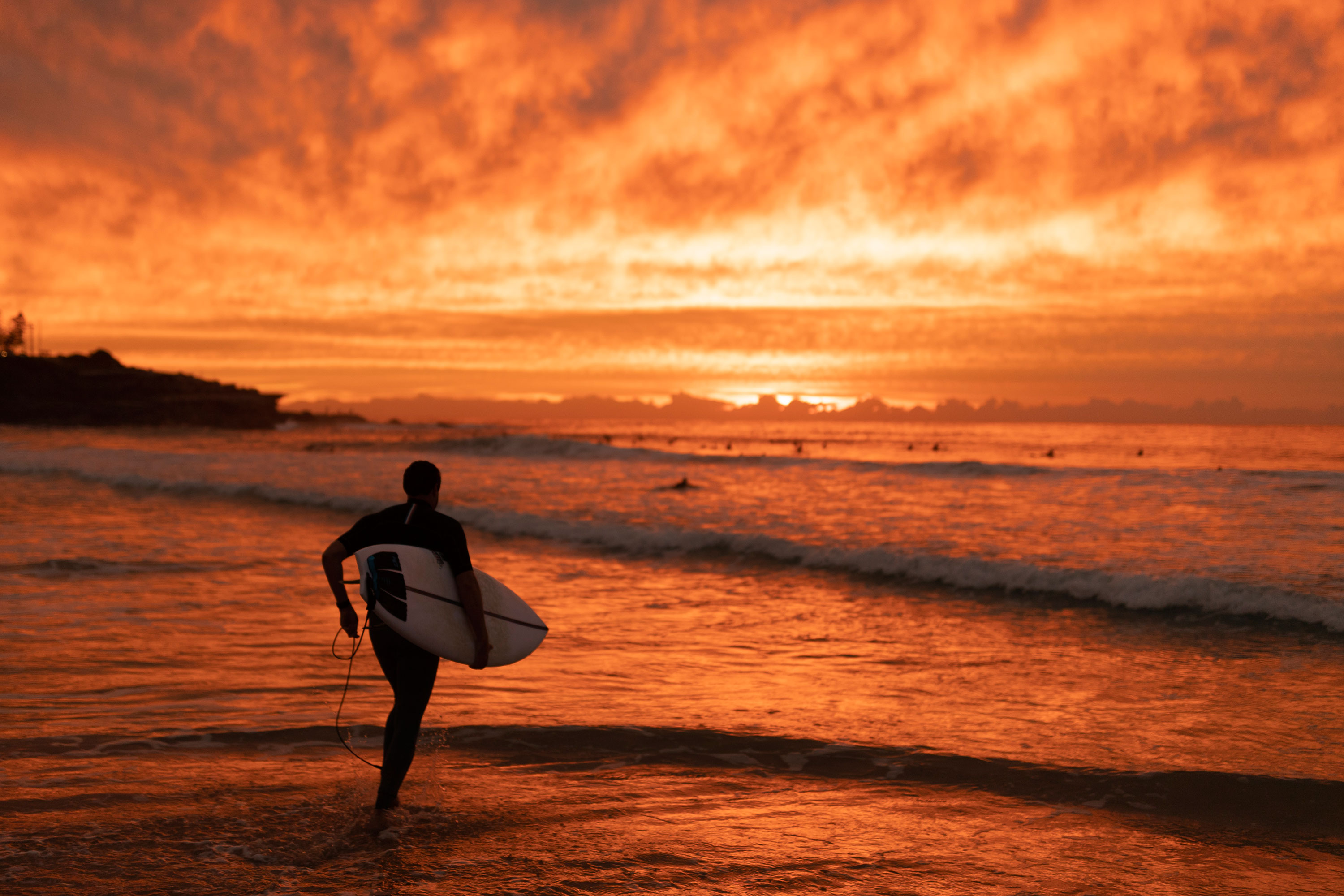 A surfer makes his way out at Maroubra beach on April 20, 2020 in Sydney, Australia. Coogee, Maroubra and Clovelly beaches in Randwick City reopened today for exercise only.