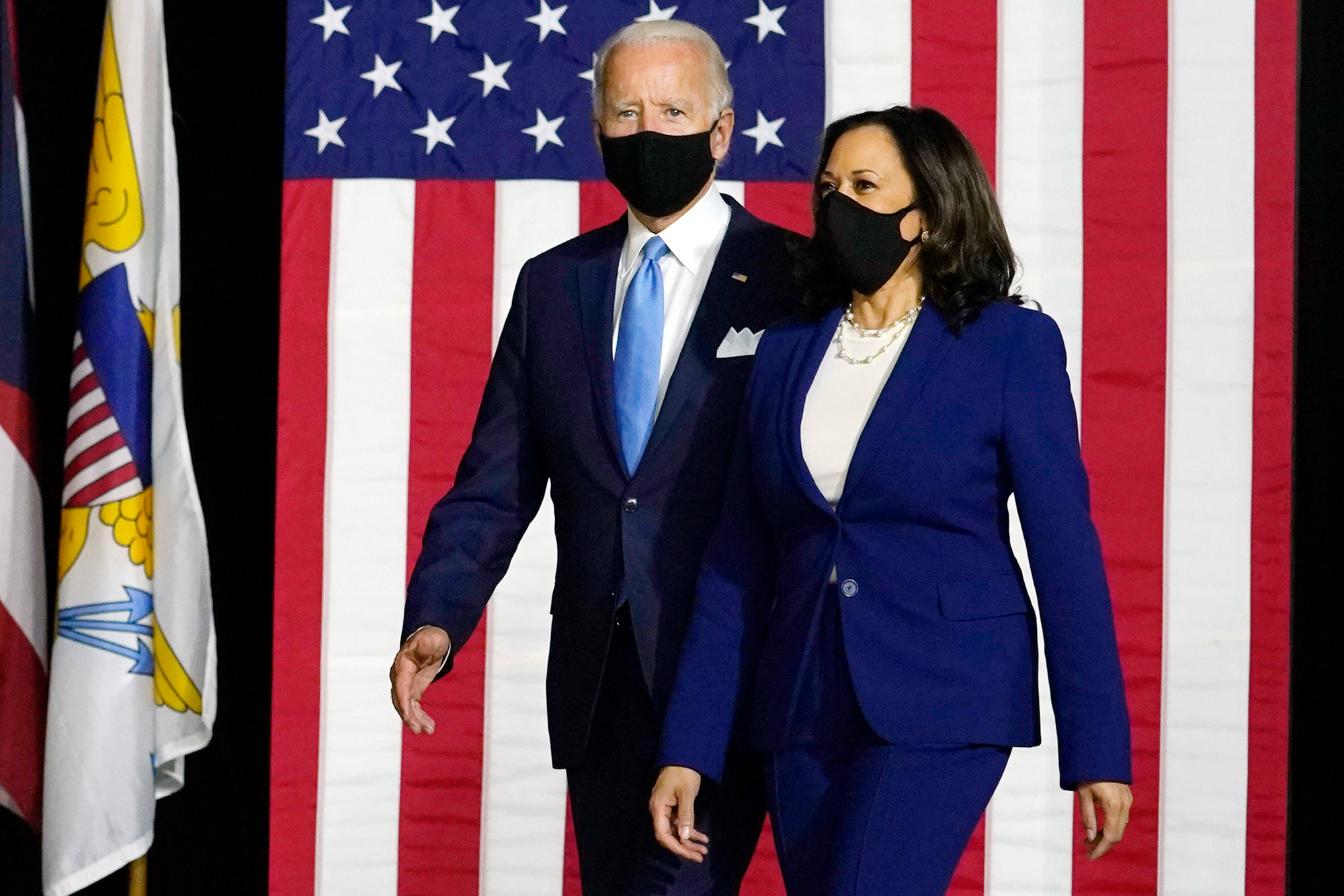 Democratic presidential candidate former Vice President Joe Biden and his running mate Senator Kamala Harris arrive to speak at a news conference at Alexis Dupont High School in Wilmington, Delaware, on August 12.