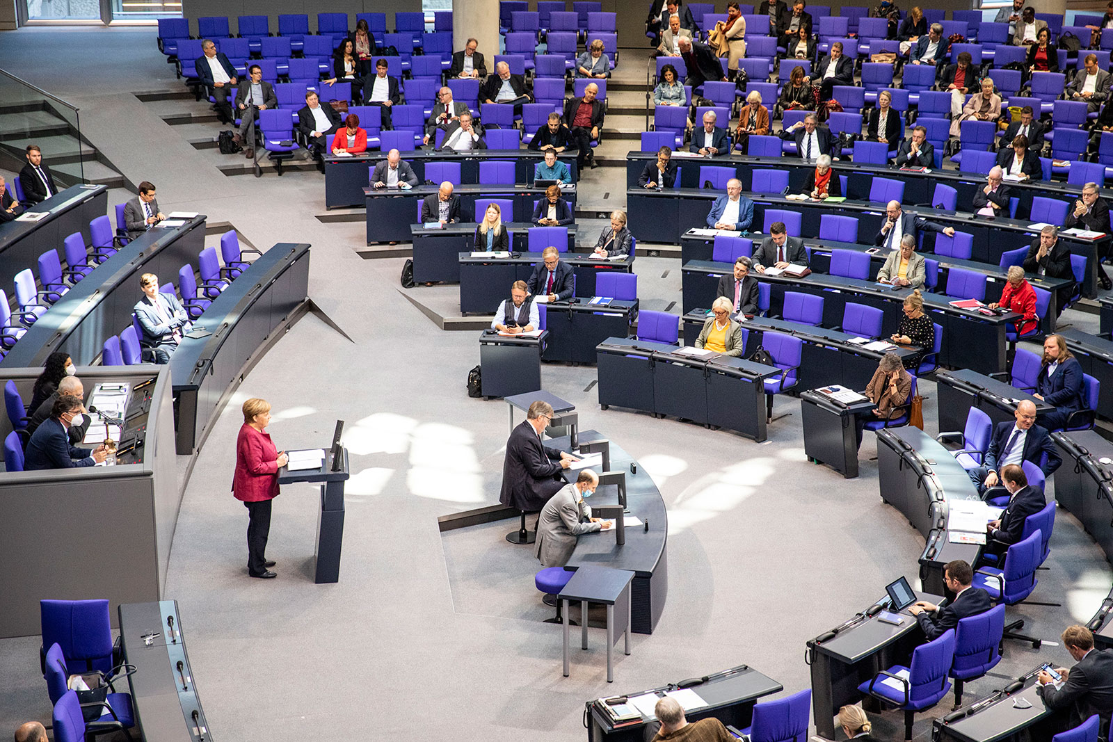 German Chancellor Angela Merkel delivers a speech during a session at the Bundestag on September 30.