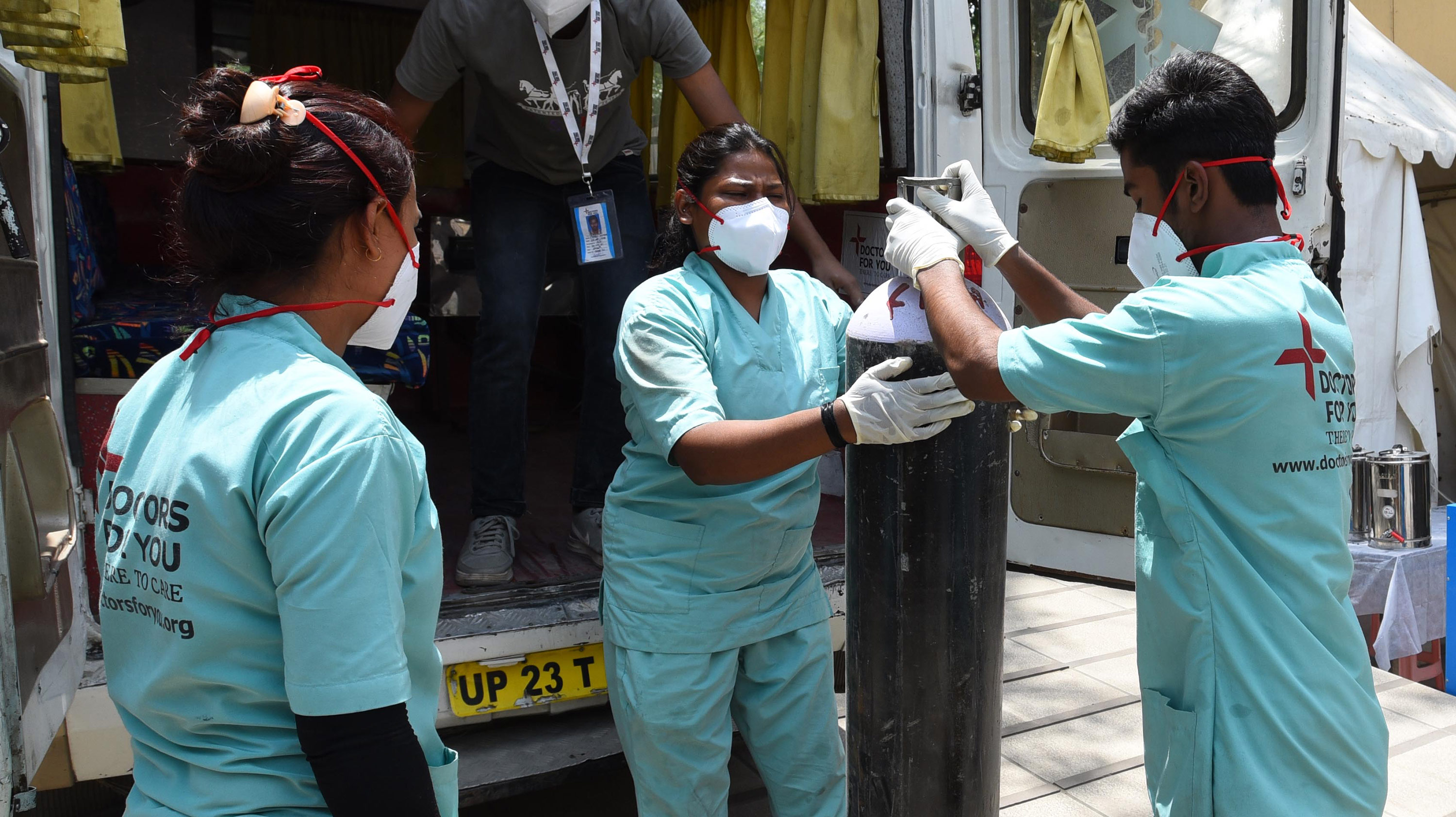 Health workers unloaded oxygen cylinders from a van at a Covid-19 care center in New Delhi, India, on May 16.