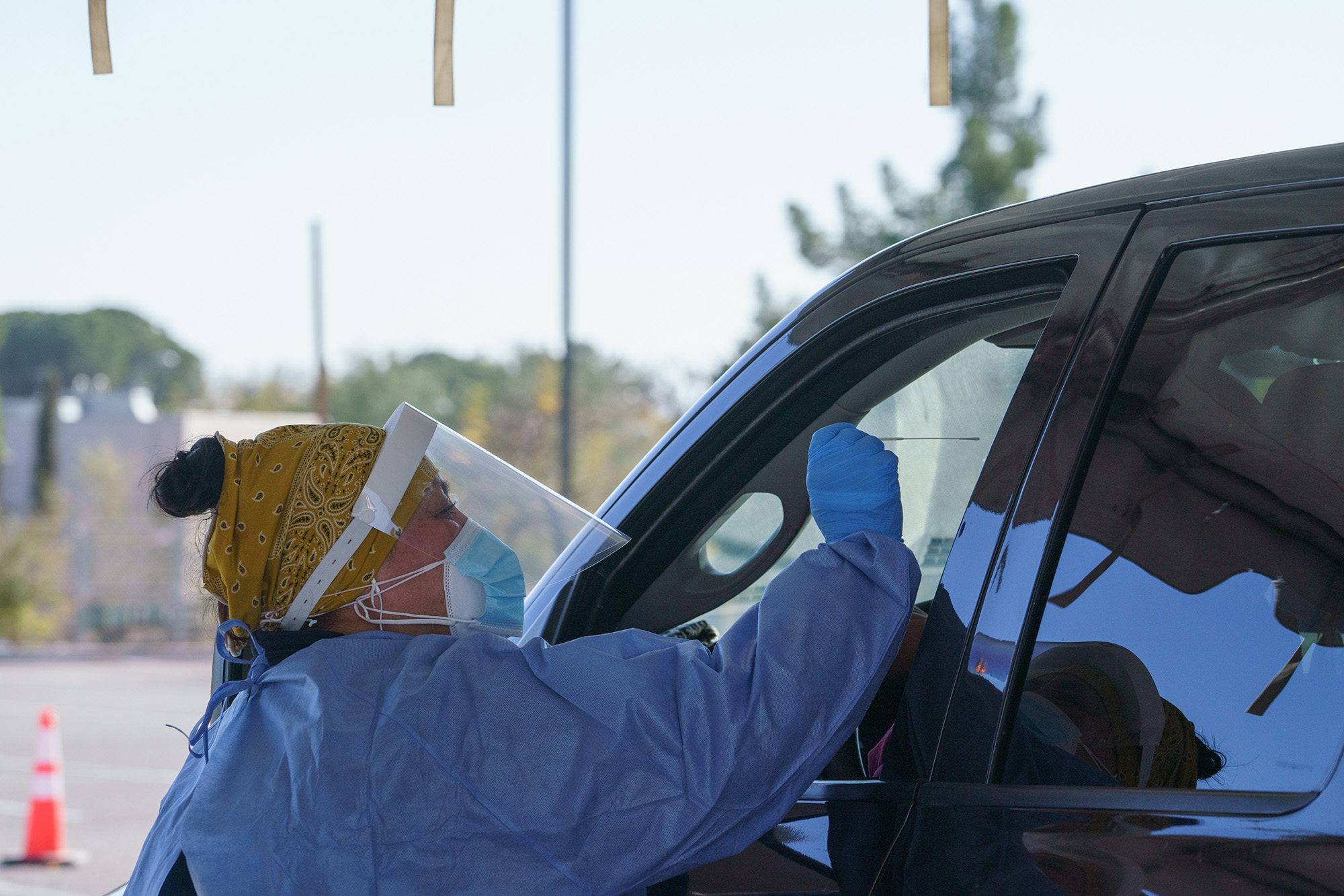 A healthcare worker administers a test at a drive-thru Covid-19 testing site in El Paso, Texas, on Monday, November 30, 2020.