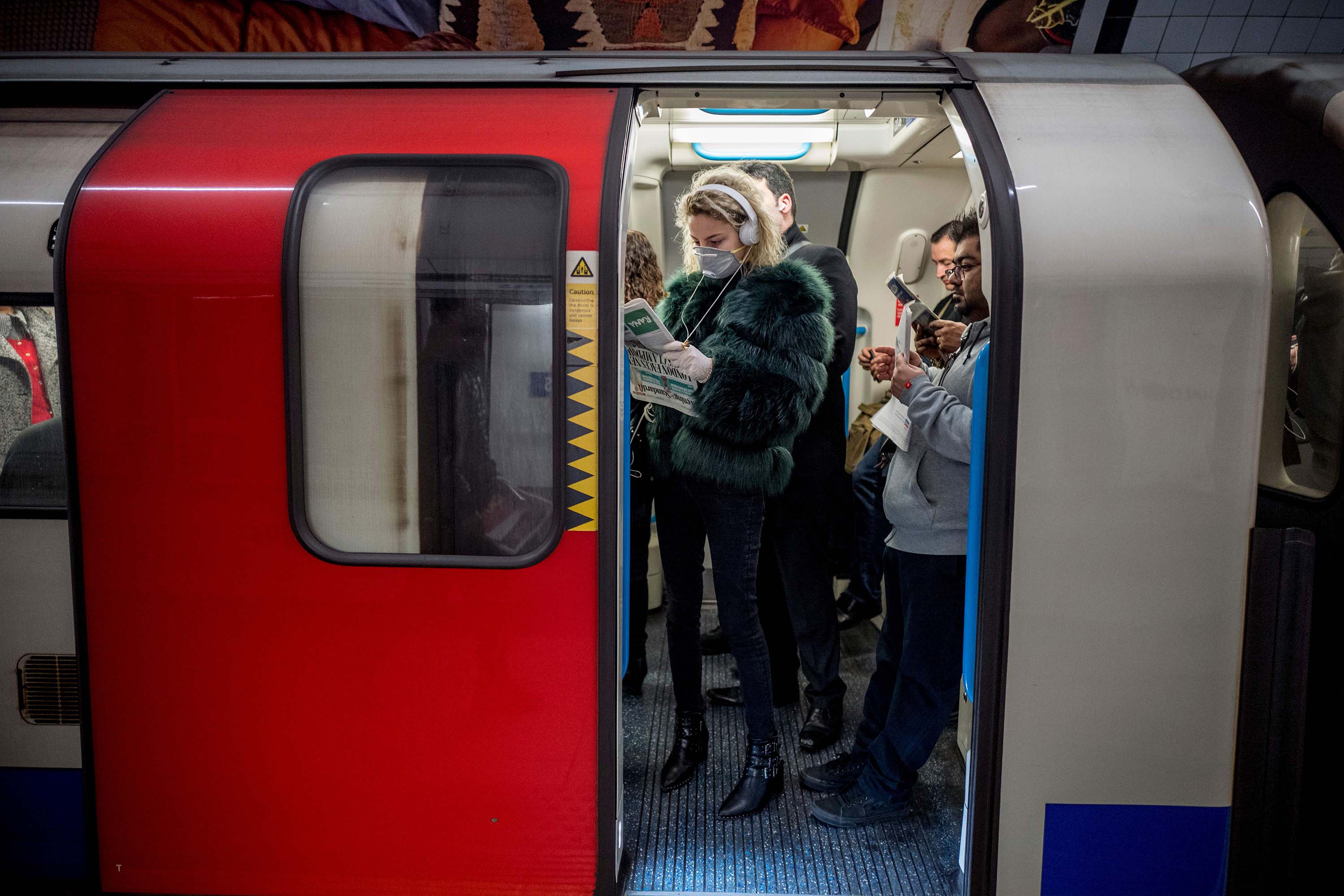 Commuters travel on a London Underground train on March 18.