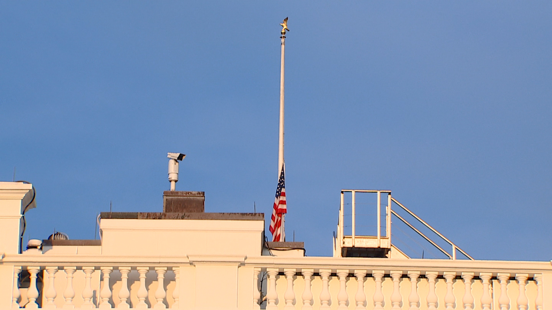 The US flag is lowered at the White House in Washington, DC, on August 26.