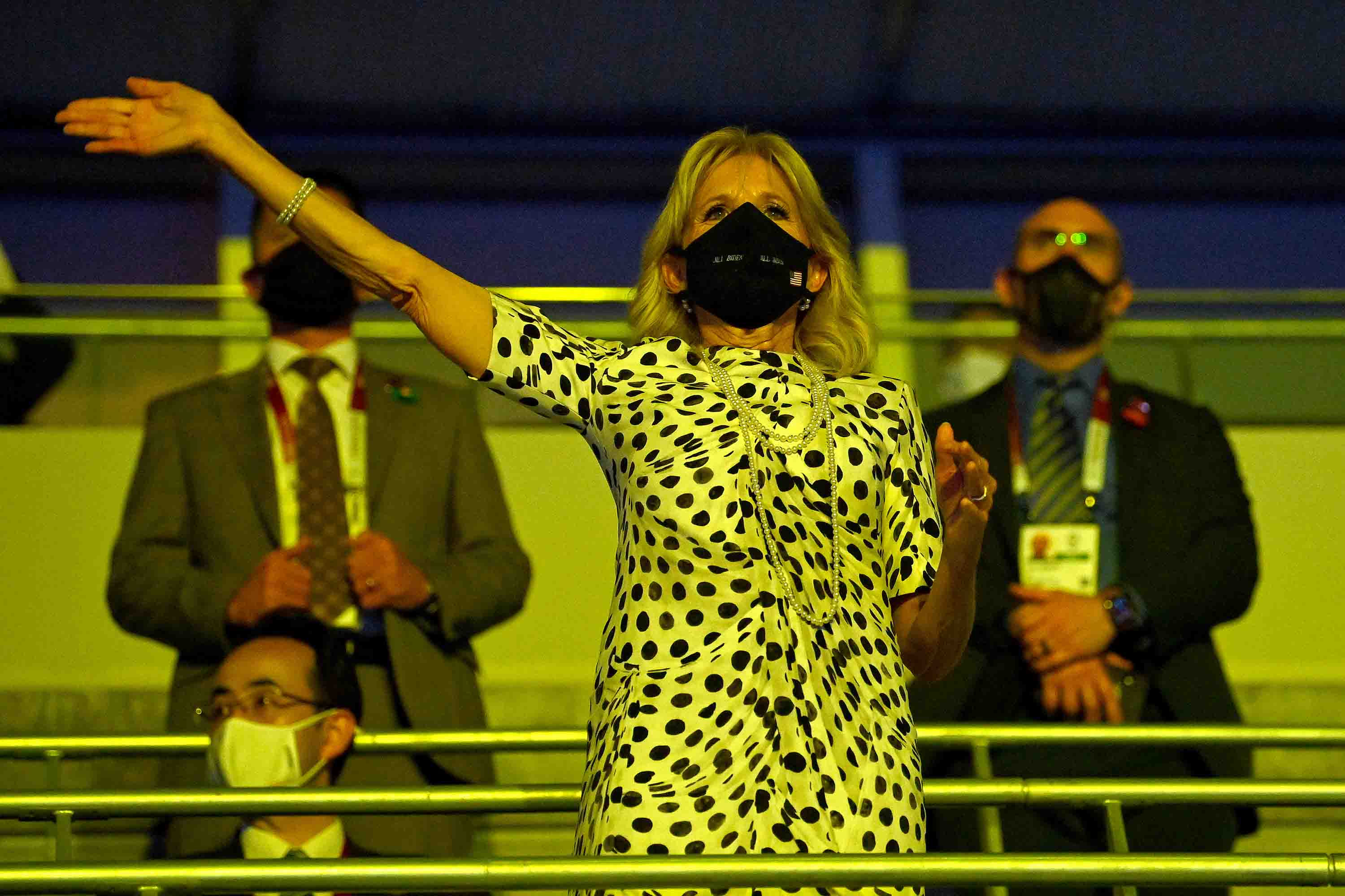 First Lady Jill Biden waves during the Opening Ceremony.