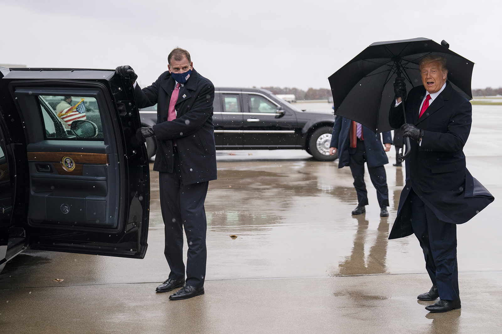 President Donald Trump arrives at Oakland County International Airport, Sunday, Nov. 1, in Waterford Township, Mich.