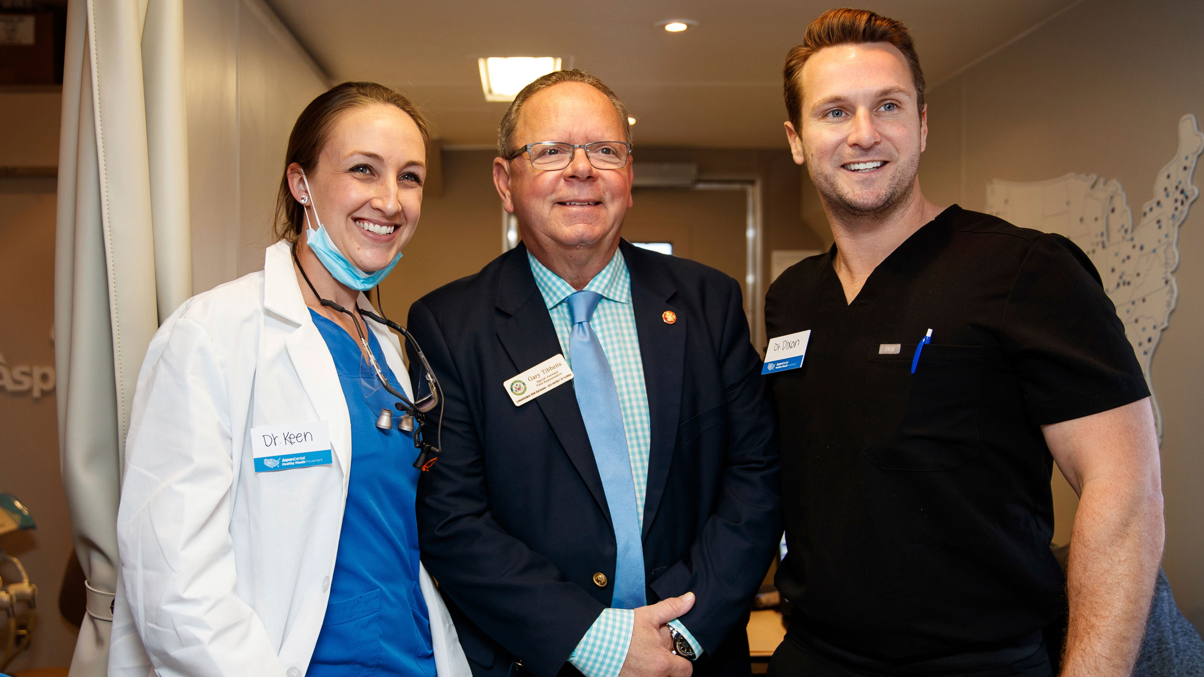 Gary Tibbetts, center, visits a mobile dental office in Bradenton, Florida, in March 2019.