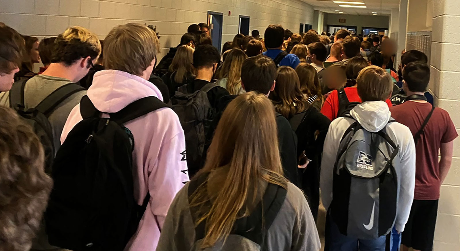 Students walk down a crowded hallway at North Paulding High School.