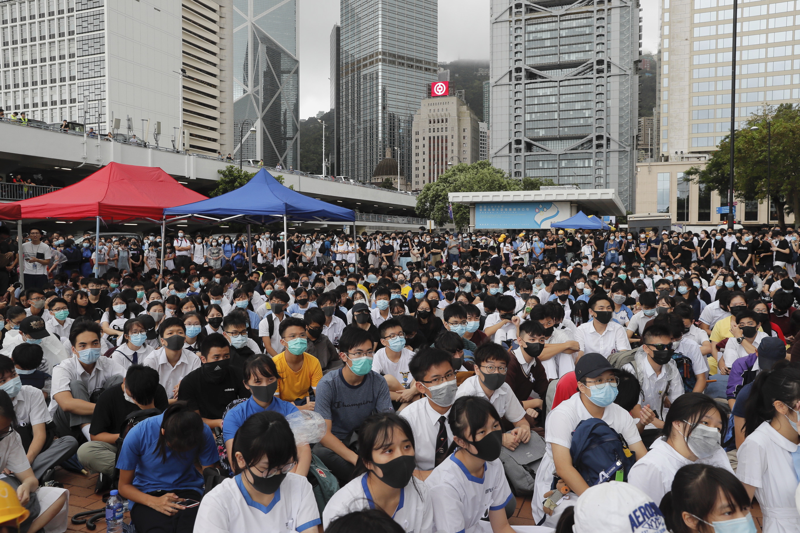 High school students sit on the ground during a protest in Admiralty in Hong Kong, on September 2, 2019.