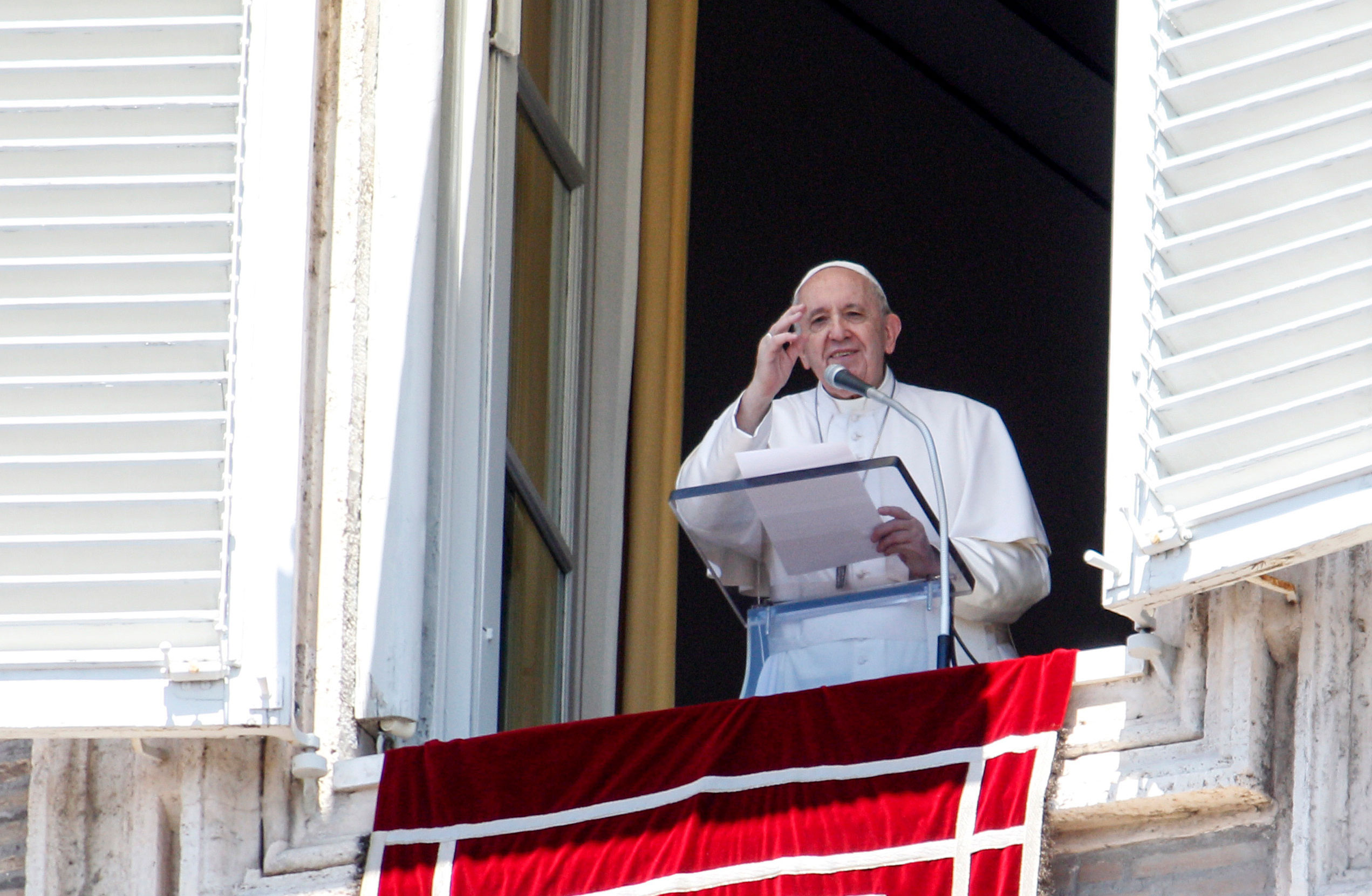 Pope Francis waves from his studio window overlooking St. Peter's Square at the Vatican on July 5.