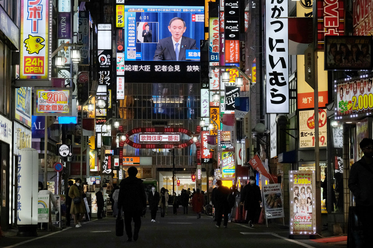 A large screen broadcasts Japanese Prime Minister Yoshihide Suga's press conference where he declares a state of emergency for the greater Tokyo area amid the Covid-19 pandemic, in Tokyo on January 7.