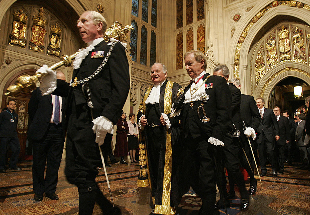 Black Rod (center, right) carrying his black rod.