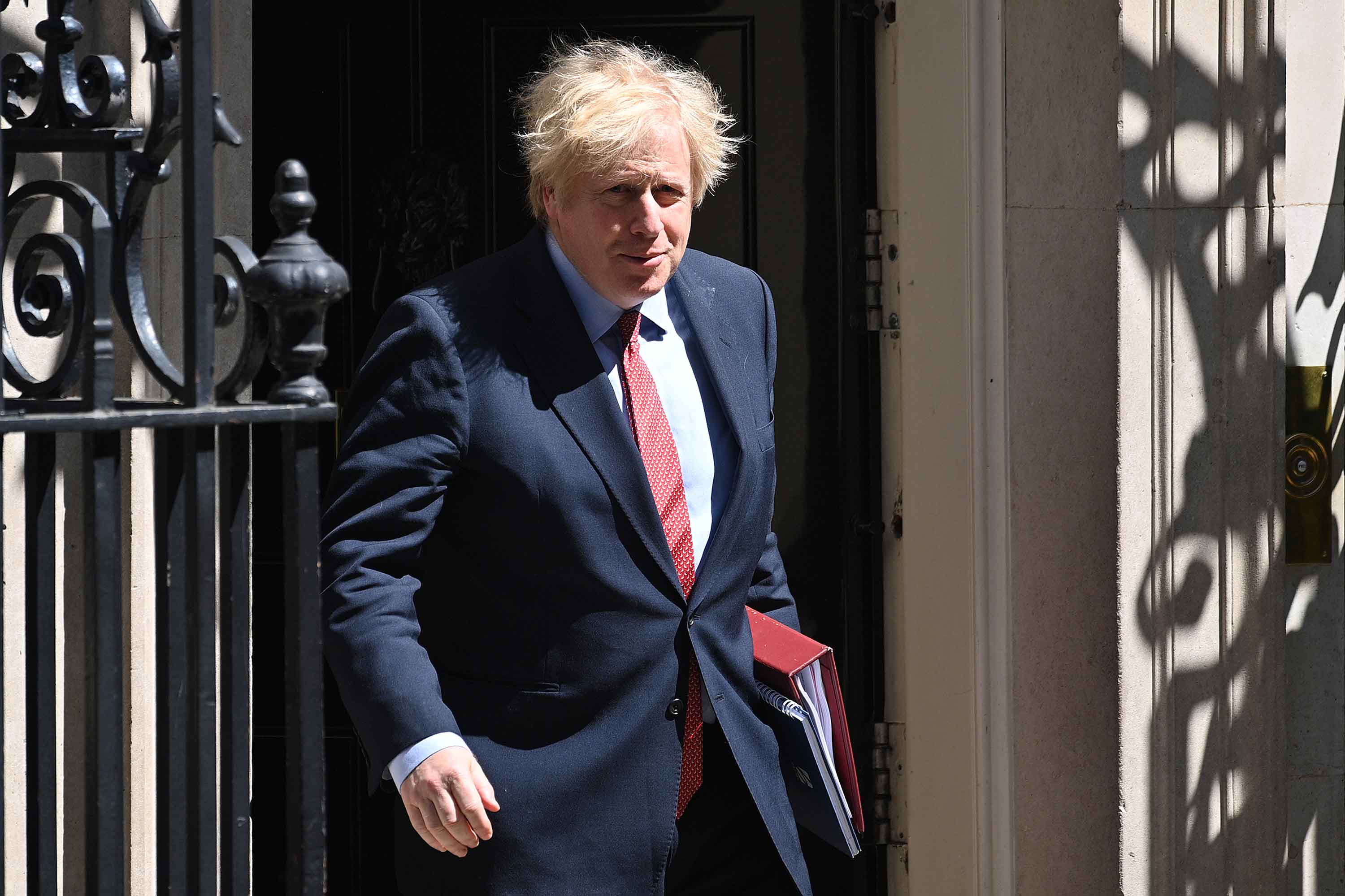 Britian's Prime Minister Boris Johnson leaves 10 Downing Street in London on May 20.