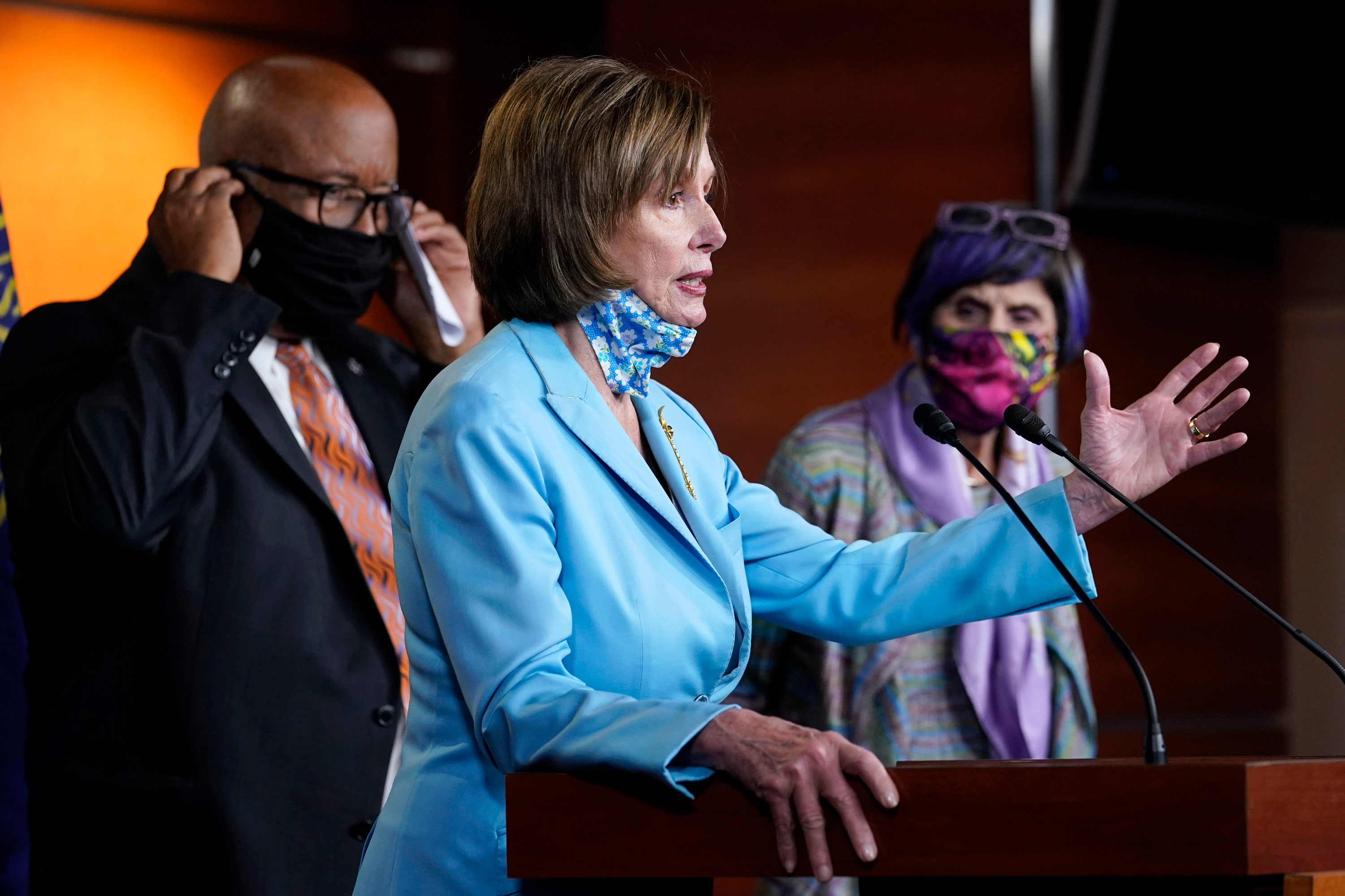 House Speaker Nancy Pelosi, center, flanked by Rep. Benny Thompson, left, and Rep. Rosa DeLauro, right, talks to reporters on Capitol Hill in Washington, DC, on May 19.