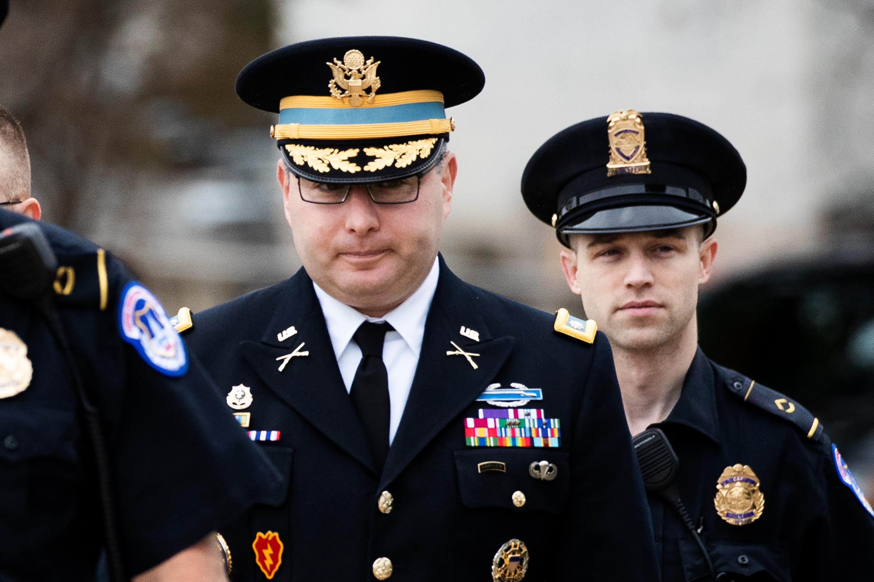 Army Lt. Col. Alexander Vindman, a member of the National Security Council, center, arrives on Capitol Hill in Washington on Oct. 29.