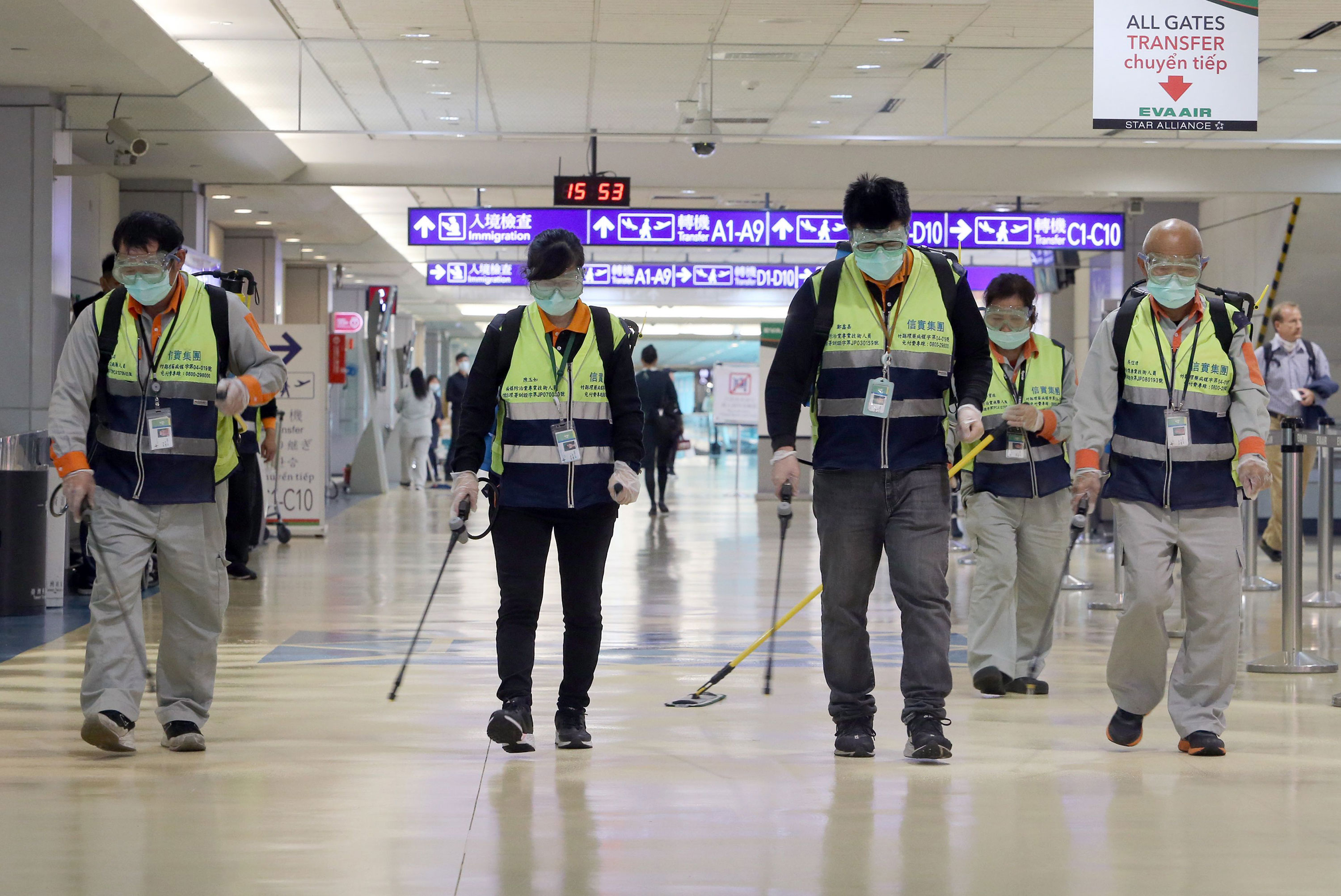 Workers disinfect a passenger throughfare at the Taoyuan International Airport in Taiwan on January 22.