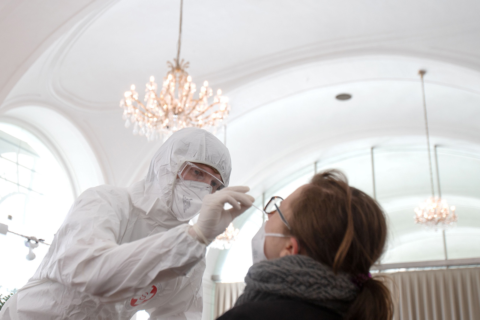 A health worker takes a coronavirus antigen rapid test swab at the new coronavirus test center in the Orangery of the Schoenbrunn Palace on February 4 in Vienna, Austria.