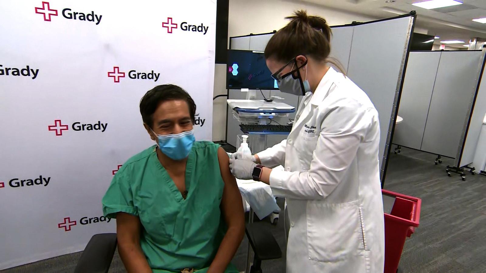 Dr. Sanjay Gupta receives a Covid-19 vaccine shot.