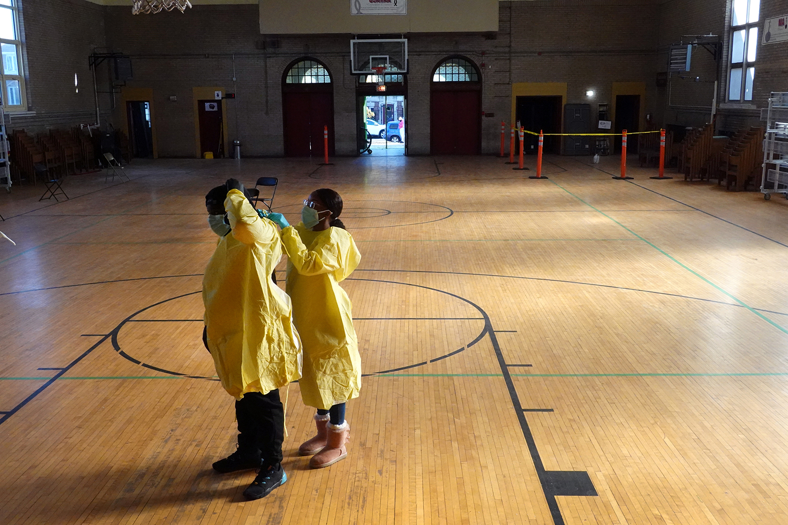 Workers suit up in personal protective equipment as they prepare to open a COVID-19 test site in the Englewood neighborhood of Chicago, on Thursday, November 12.