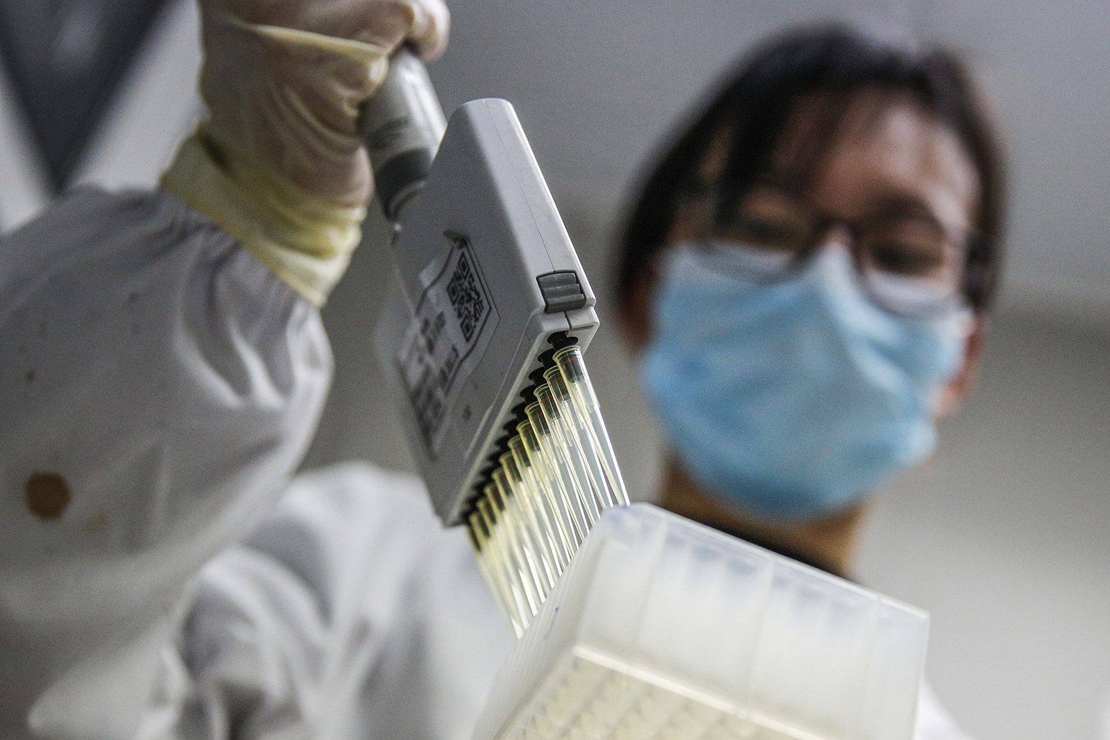 A staff member tests samples of inactivated Covid-19 vaccine at a Sinovac Biotech lab in Beijing on March 16.
