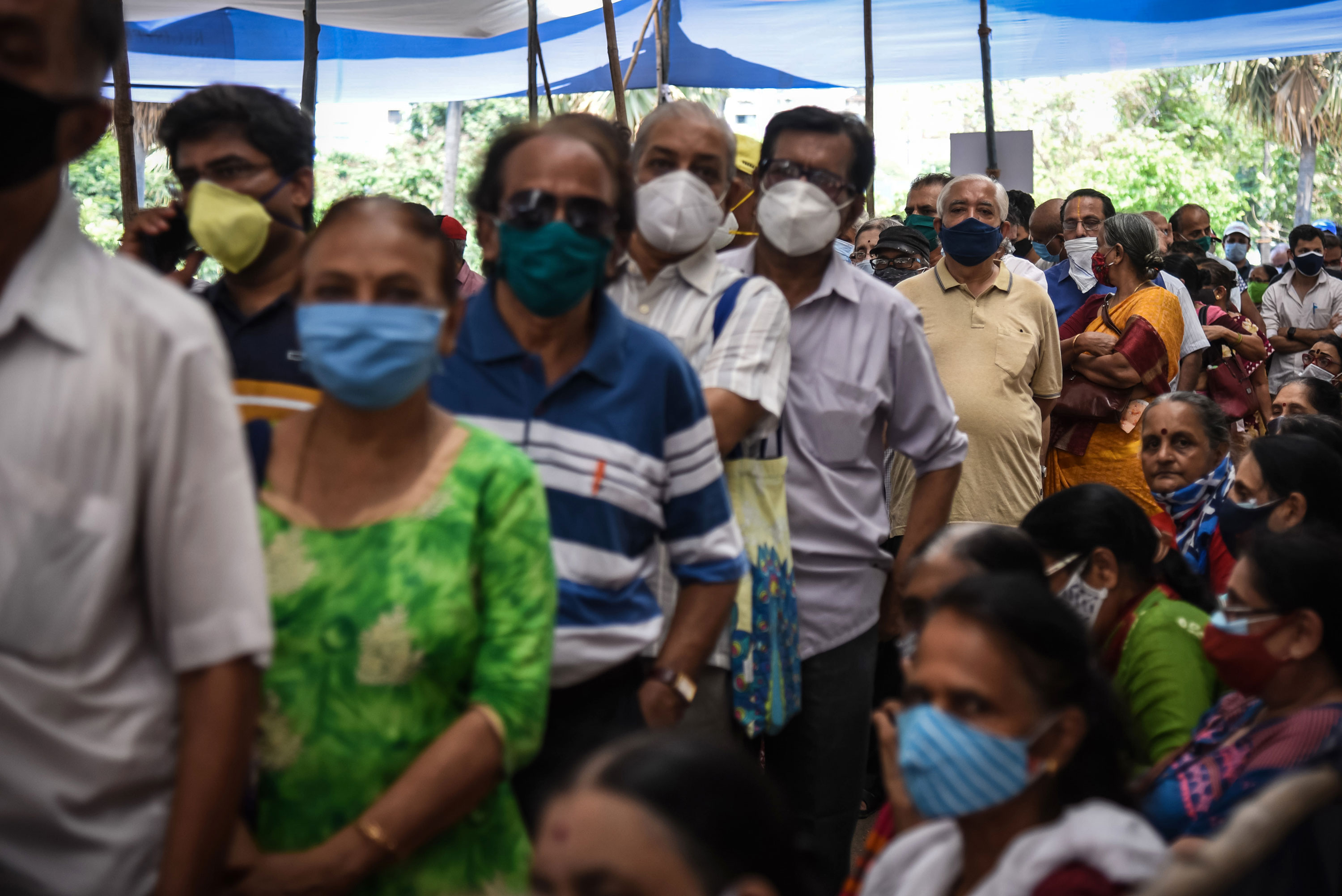 People wait to receive a Covid-19 vaccination on April 29 in Mumbai, India.