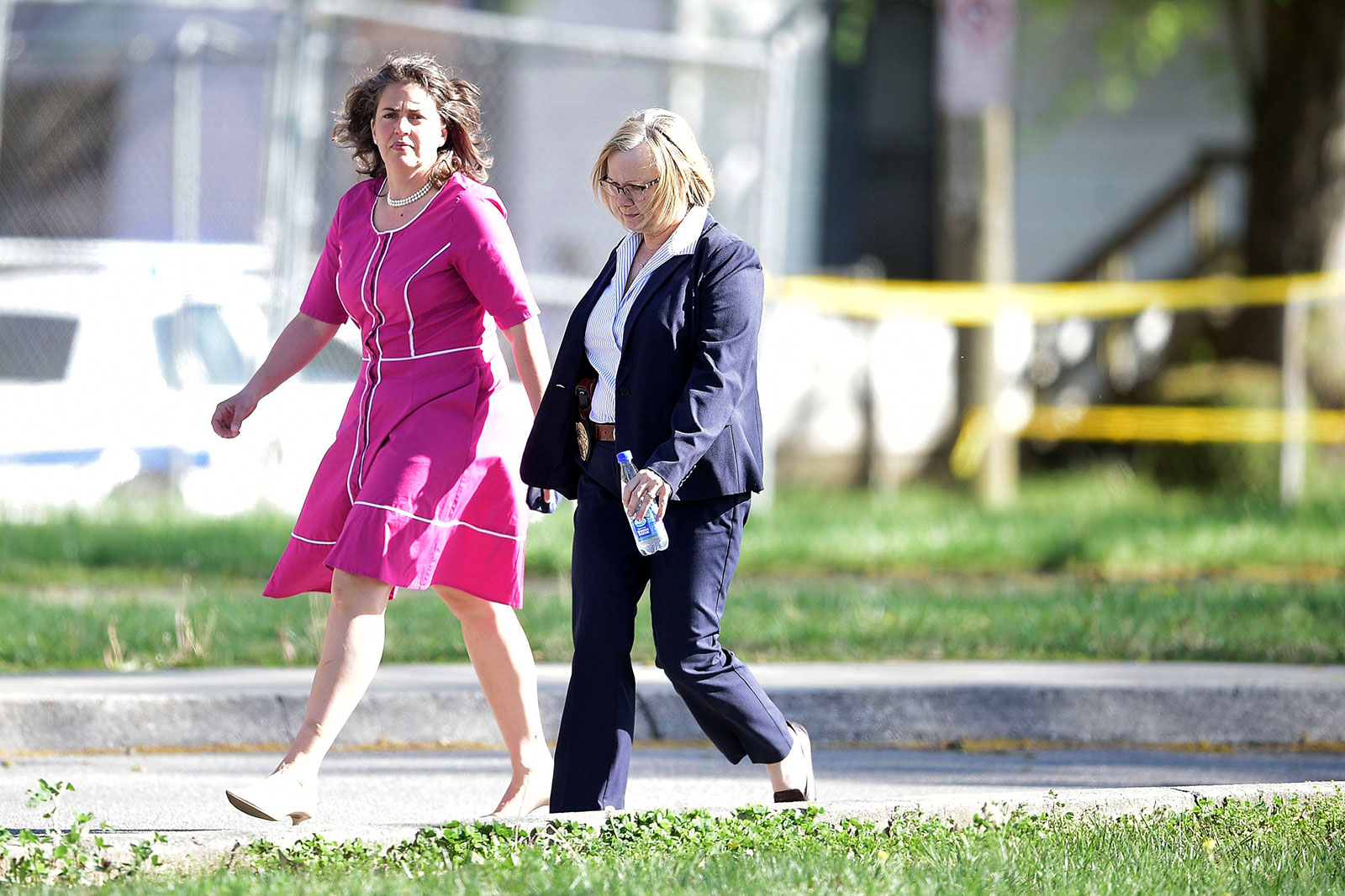 Knoxville Mayor Indya Kincannon, in pink, arrives at the scene of a shooting at Austin-East High School in Knoxville, Tennessee, on Monday, April 12.